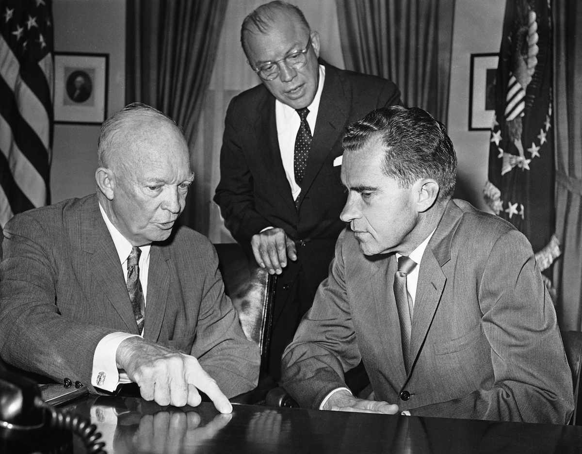 Vice Pres. Richard Nixon, right, meets with Pres. Dwight D. Eisenhower, left, at the White House to report on his tour of the Soviet Union and visit to Poland, Aug. 5, 1959, Washington, D.C. Milton Eisenhower, the President's brother, who accompanied Nixon, is with them.
