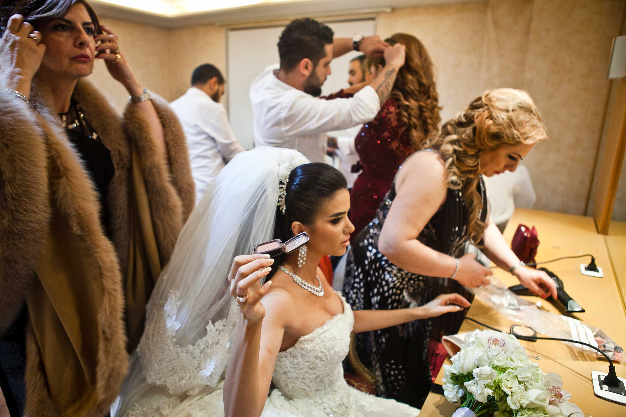 Jessica Obeid and her female relatives fix ther make up in her holding room before she enters her large wedding. Her mother, Leila Obeid, is a famous beauty consultant featured on National television.