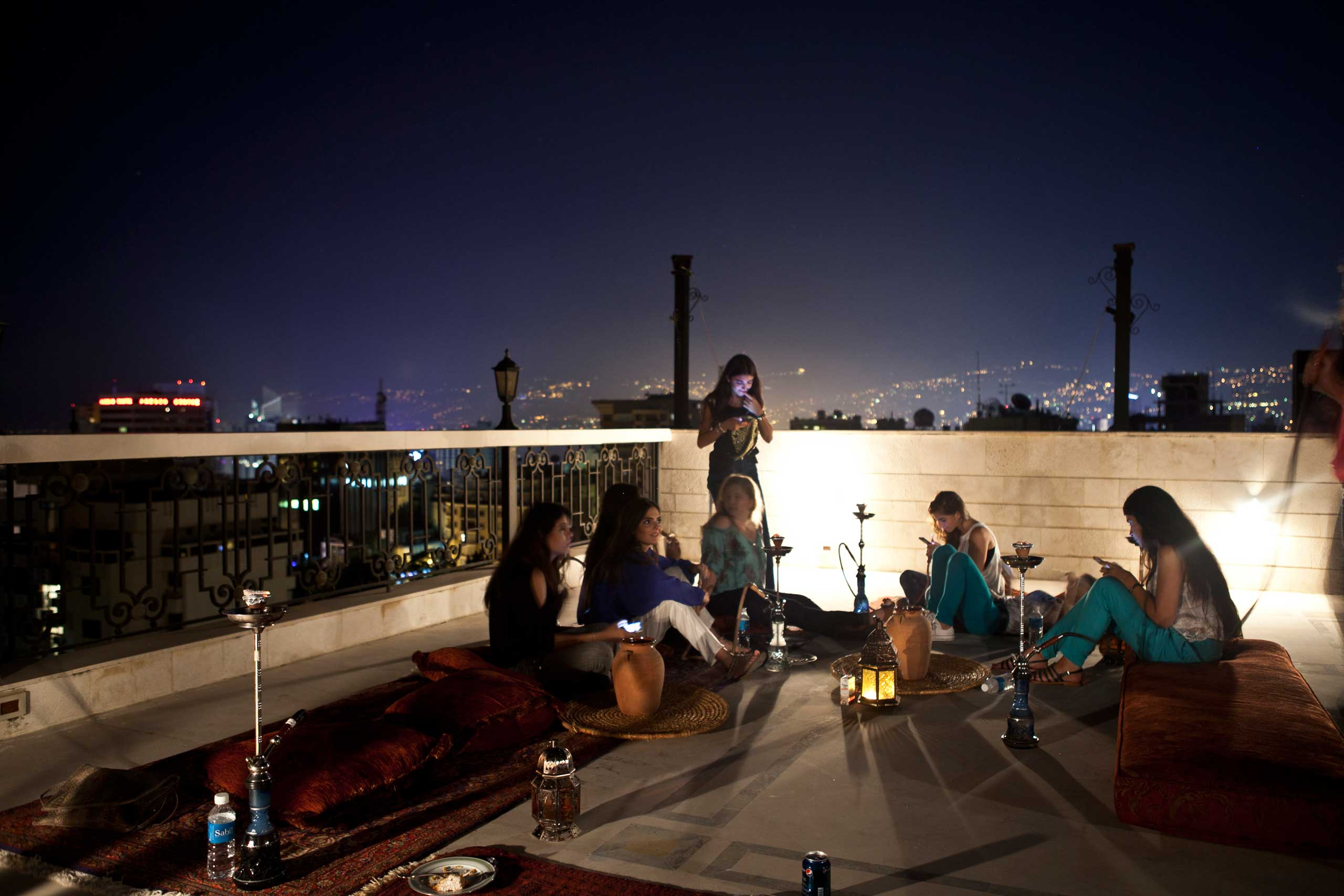 Lebanese teenagers socialize in Ramadan, on a residential rooftop before the sun comes up and they need to fast.