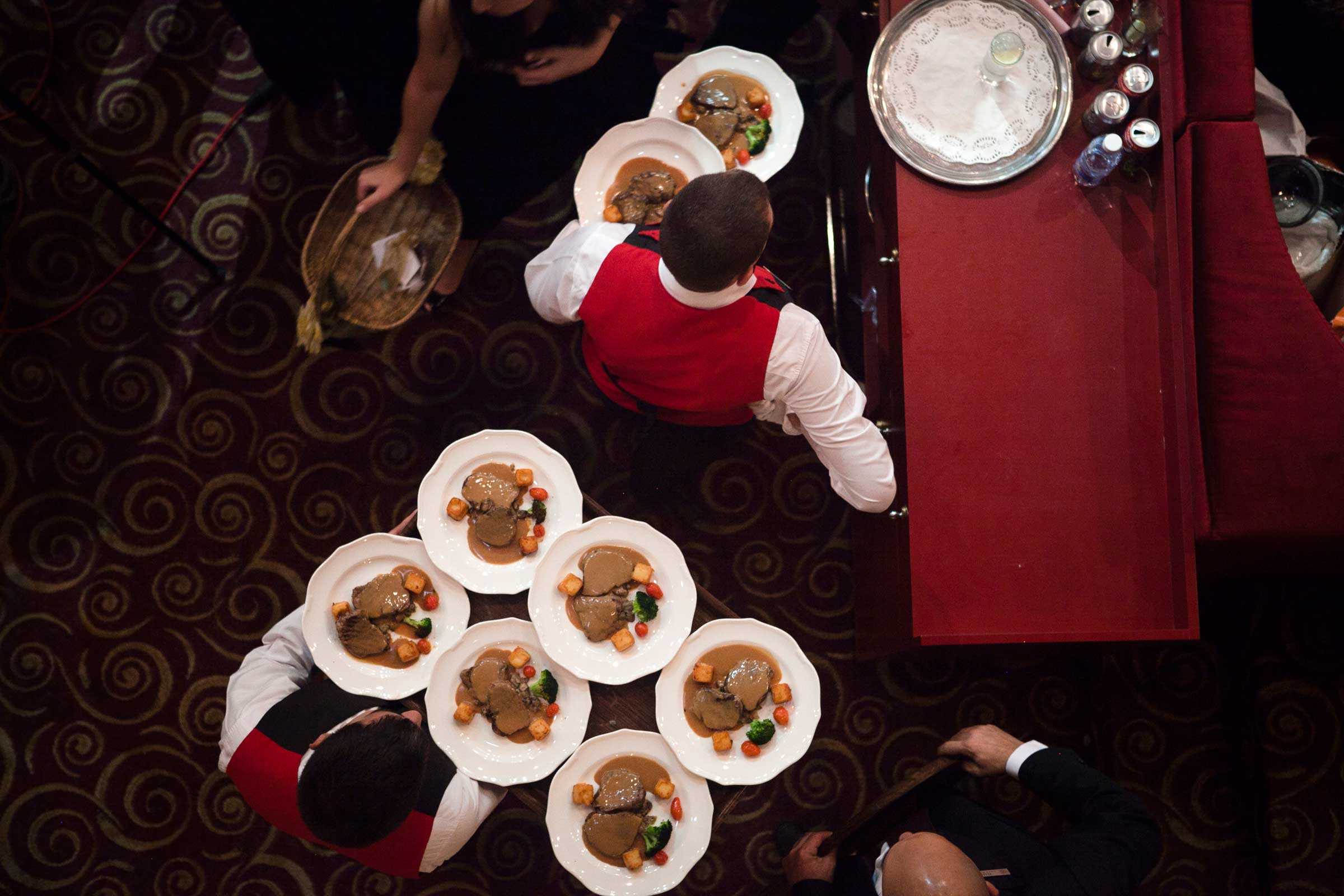 Dinner of beef steak is served for 600 people, tickets for the Ball ranged from $150 or $200.