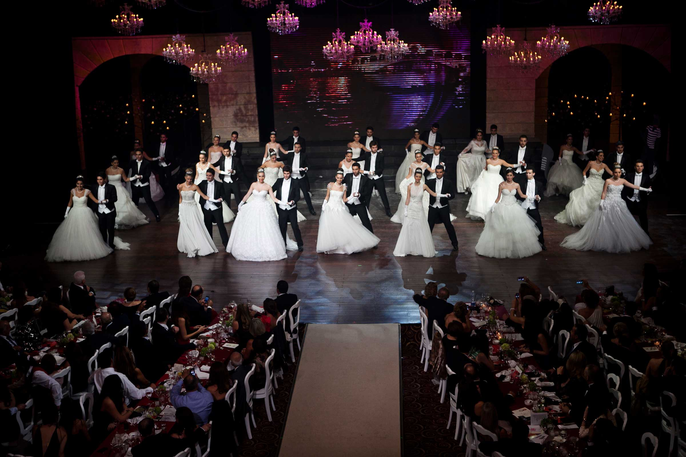 Debutante ladies dance with their partner at the Debutante Ball infront of an audience of 600 people, tickets for the Ball ranged from $150 or $200.