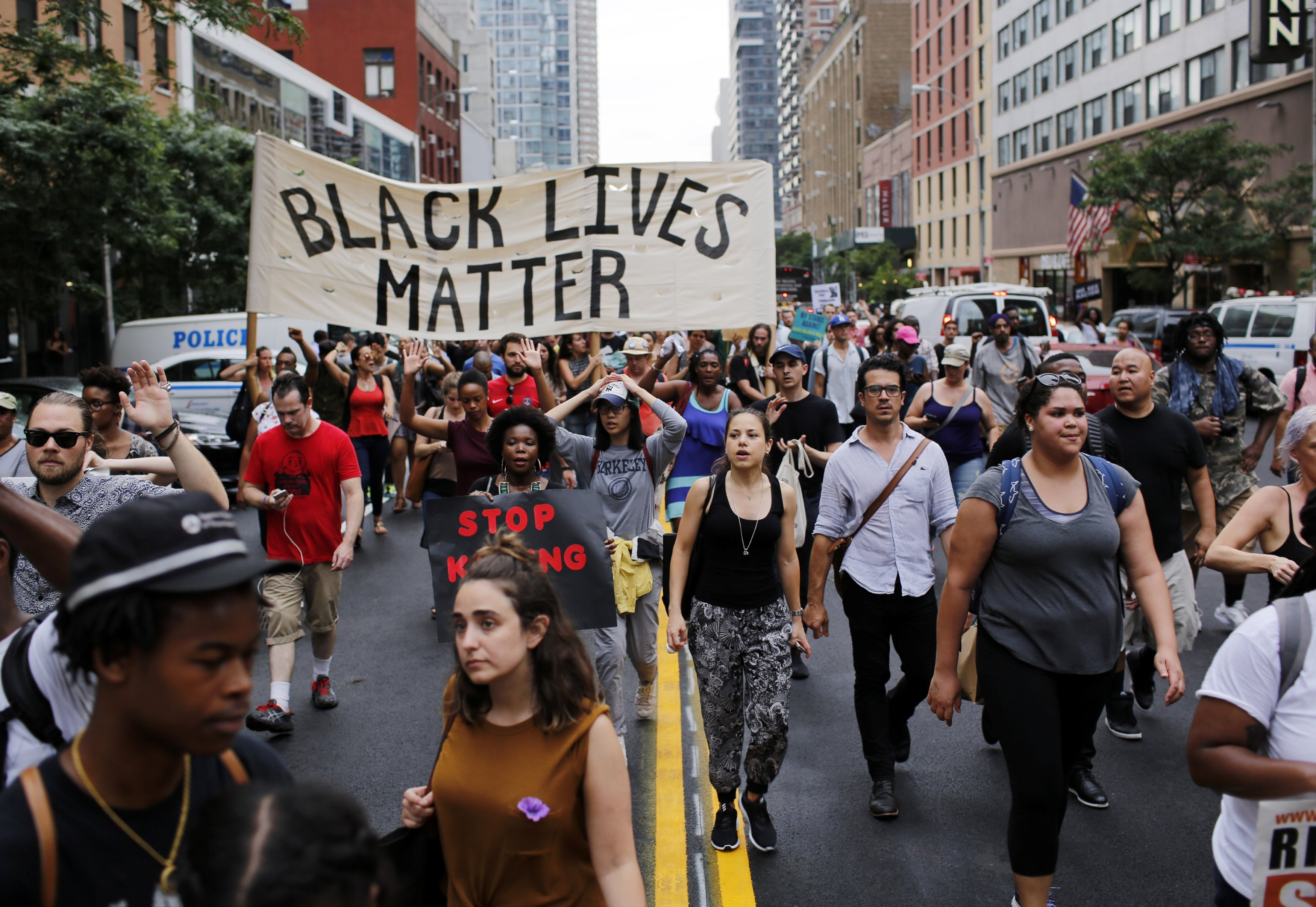 People take part in a protest for the killing of Alton Sterling and Philando Castile during a march along Manhattan's streets in New York, on July 7, 2016.