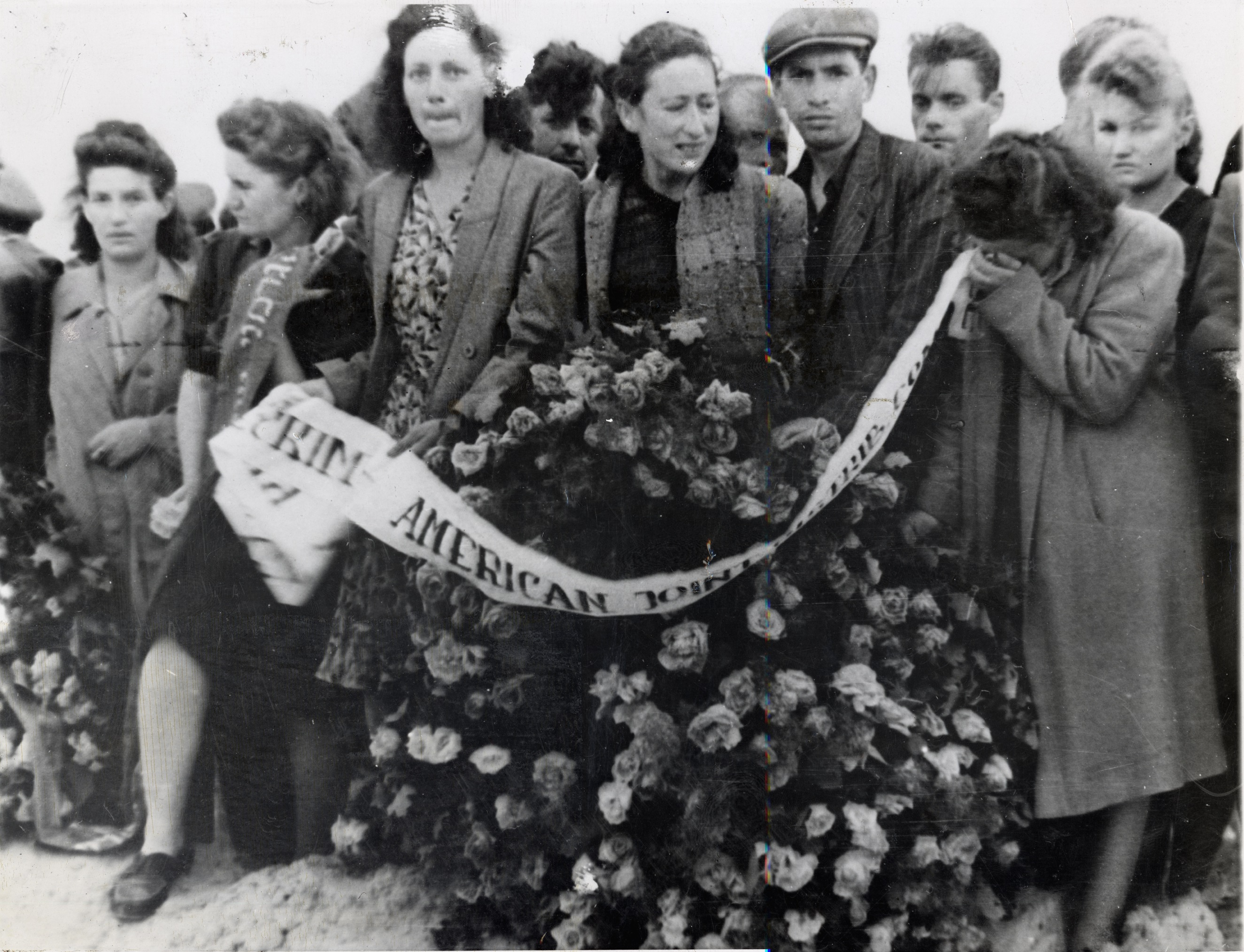 The Joint delegation at the funeral of victims of the Kielce pogrom, Poland, 1946. This pogrom, so soon after World War II, sparked the emigration of tens of thousands of Polish Jewish survivors immediately after the war.