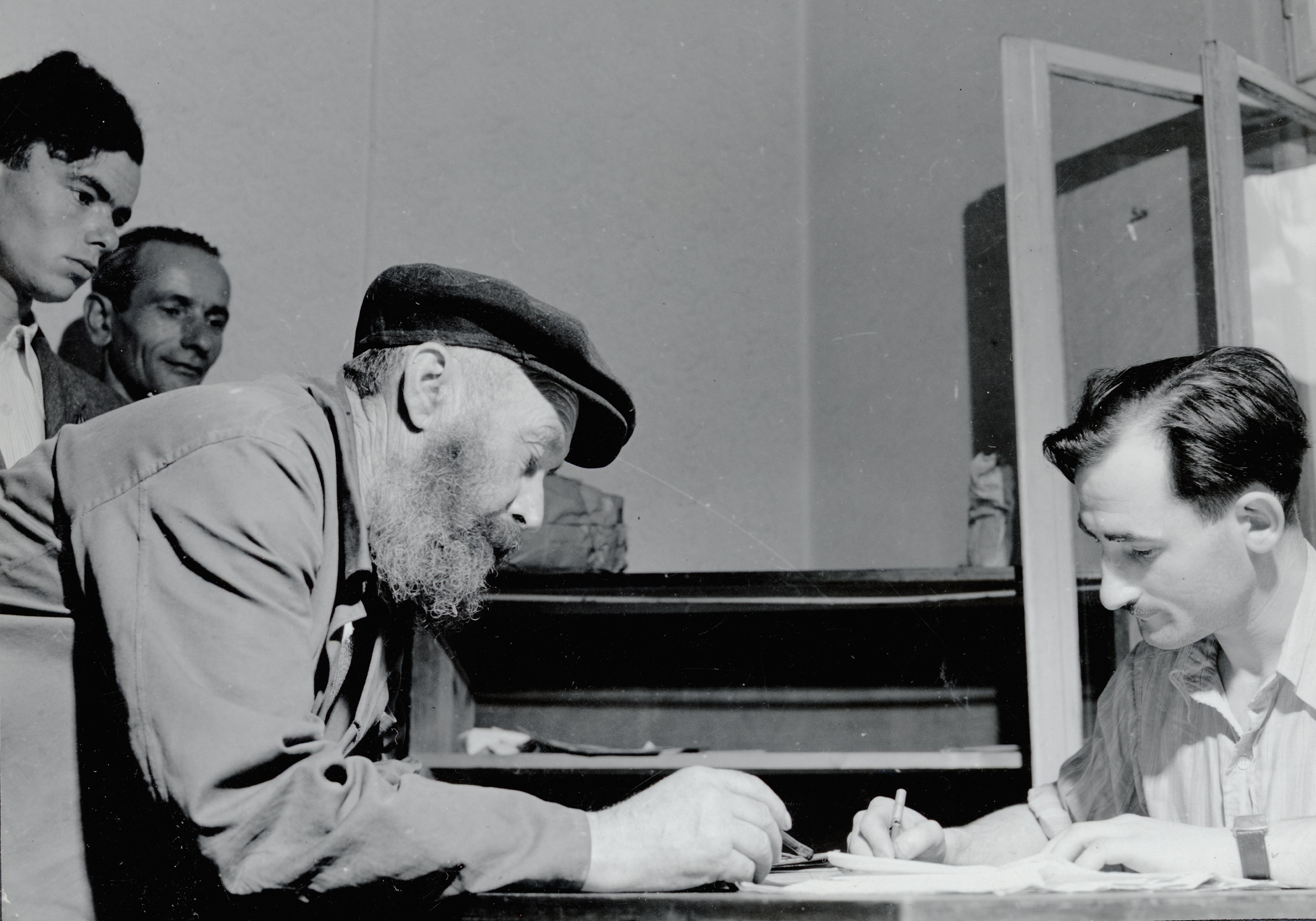 Jewish survivors registering at the employment service of the Central Committee of Jews in Poland, Klodzko, 1946.