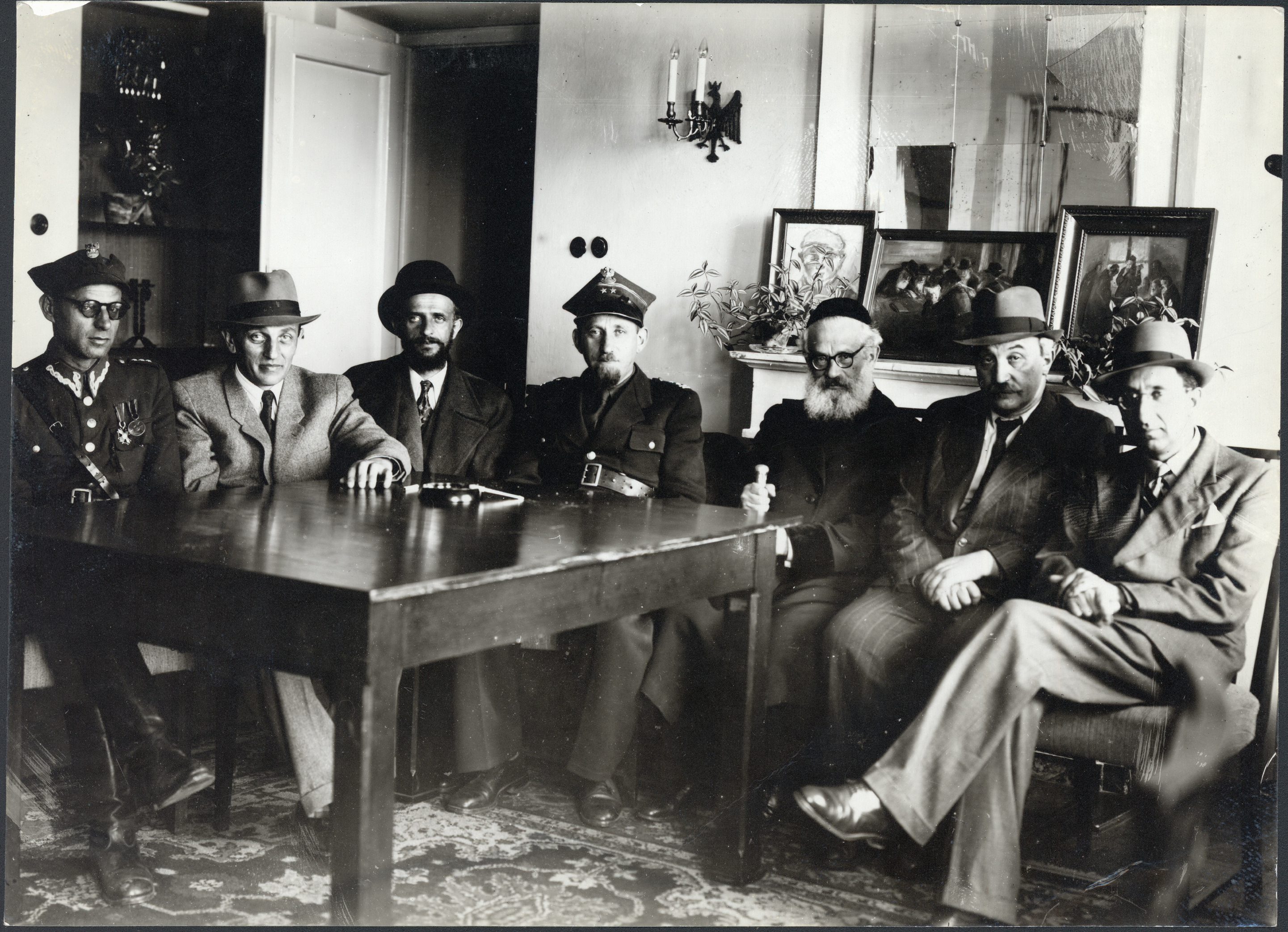 Visit of the Chief Rabbi of Jerusalem to the JDC offices in Warsaw; left to right in photo: Captain Beker, Mizrachi; Mr. Zylberberg, secretary-general of the Central Religious Congregation; Rabbi Efrusi of Warsaw; Colonel Kahane, chief rabbi of the Polish Army; Rabbi Isaac Herzog, chief rabbi of Jerusalem; Mr. Atbor, president of the Jewish Religious Congregation in Lodz; and Joseph Gitler-Barski; general secretary of the JDC office in Warsaw; c. 1946.