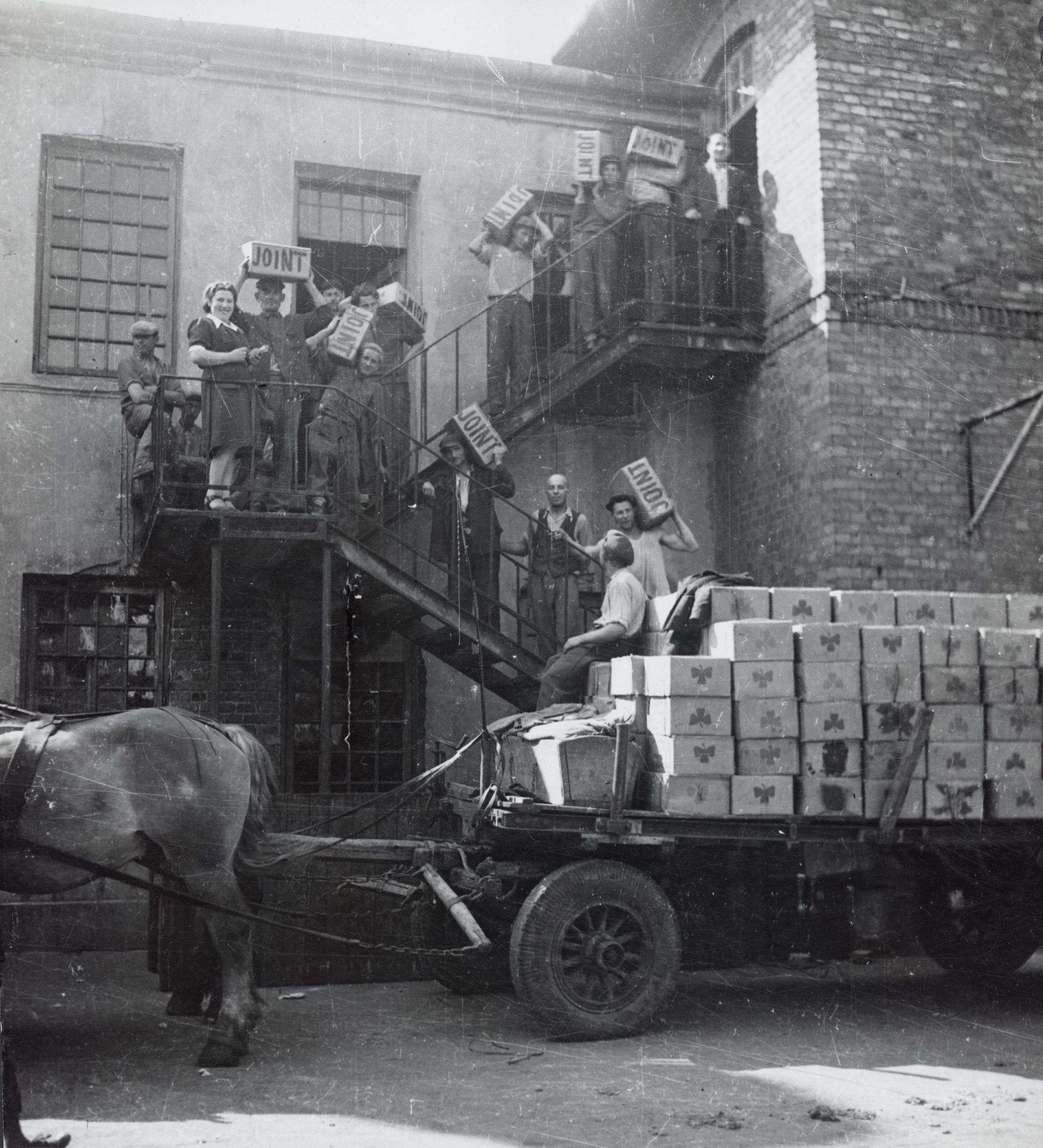 """Transporting of supplies labeled """"Joint"""" to a warehouse, Warsaw, c. 1946-47."""