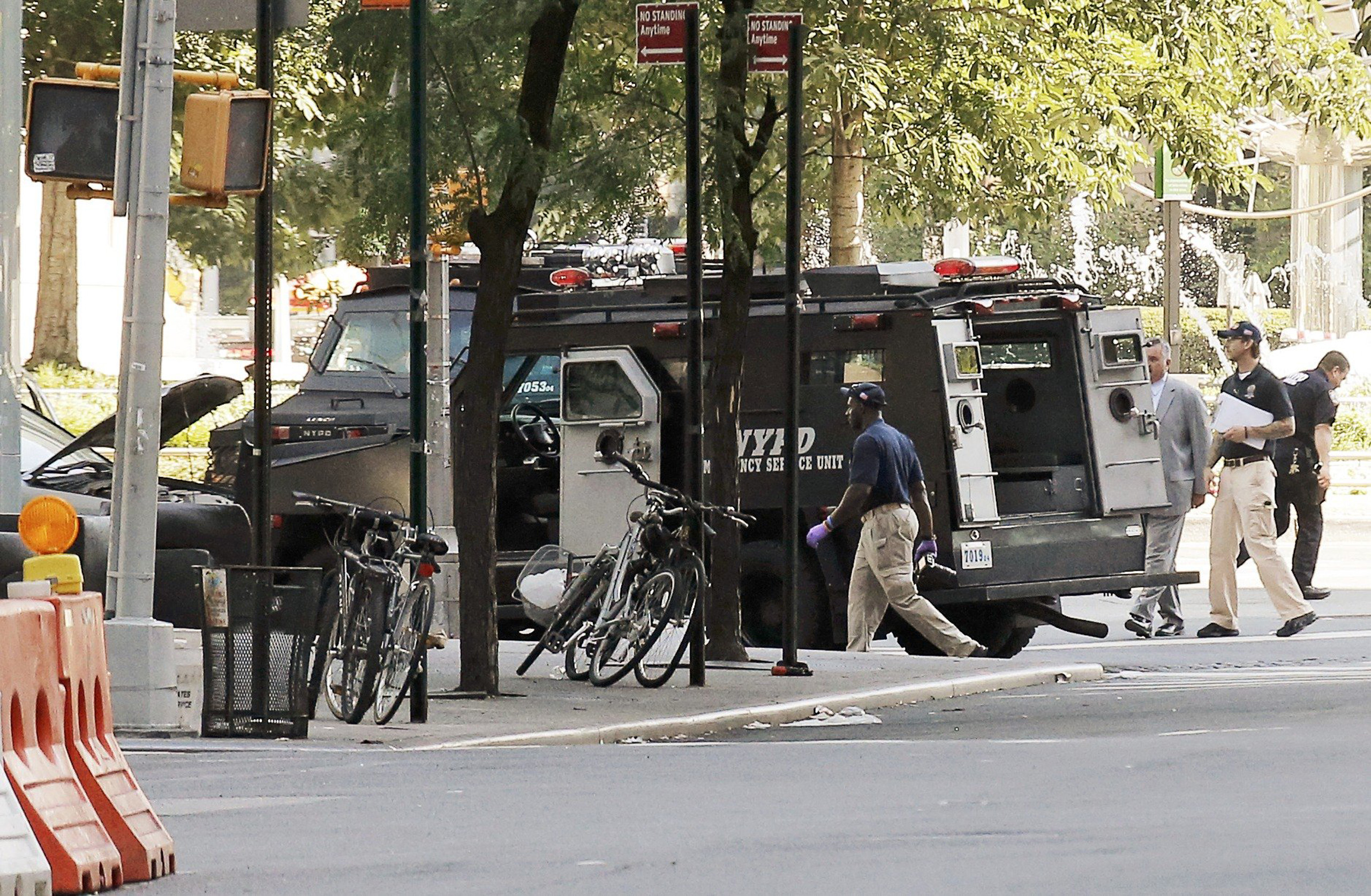 Police investigate the scene near an SUV in which a man suspected of causing a bomb scare barricaded himself, causing an hours-long standoff and the shutdown of a mid-Manhattan area in New York City on July 21, 2016.