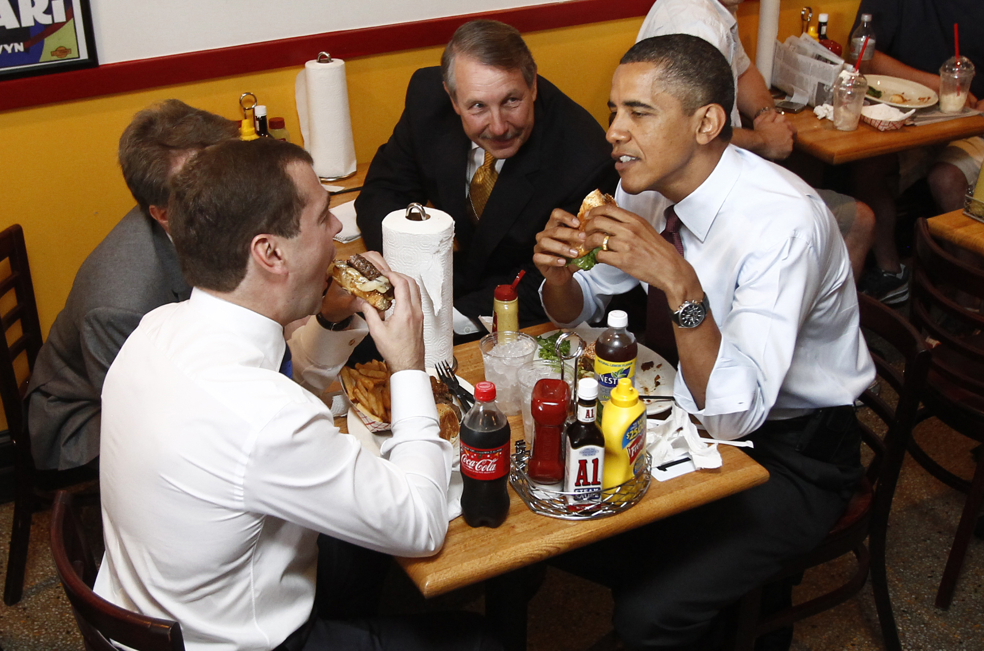 Barack Obama and Russia's President Dmitry Medvedev have burgers at Ray's Hell Burger restaurant in Arlington, Virginia, June 24, 2010.