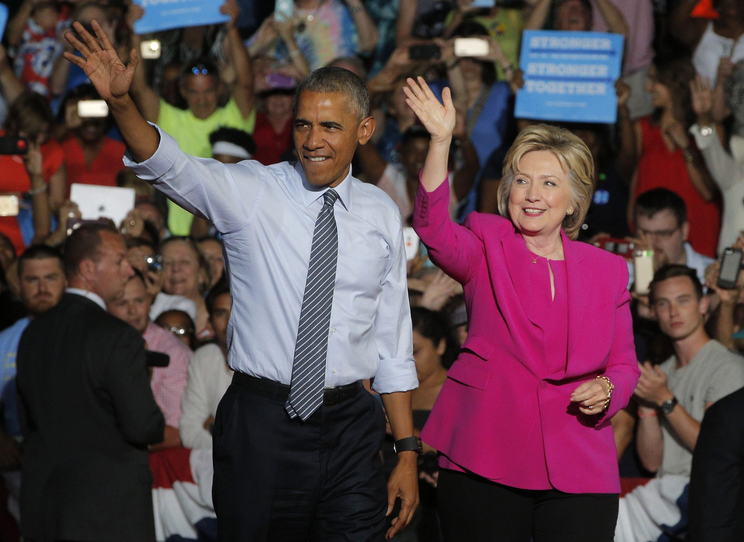 President Barack Obama waves with Democratic U.S. presidential candidate Hillary Clinton during a Clinton campaign event in Charlotte, July 5, 2016.