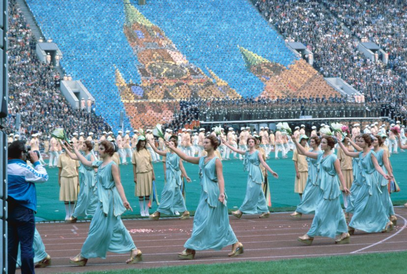 Moscow, 1980Women dressed in Greek costumes form a procession in front of a human mosaic depicting the Kremlin.