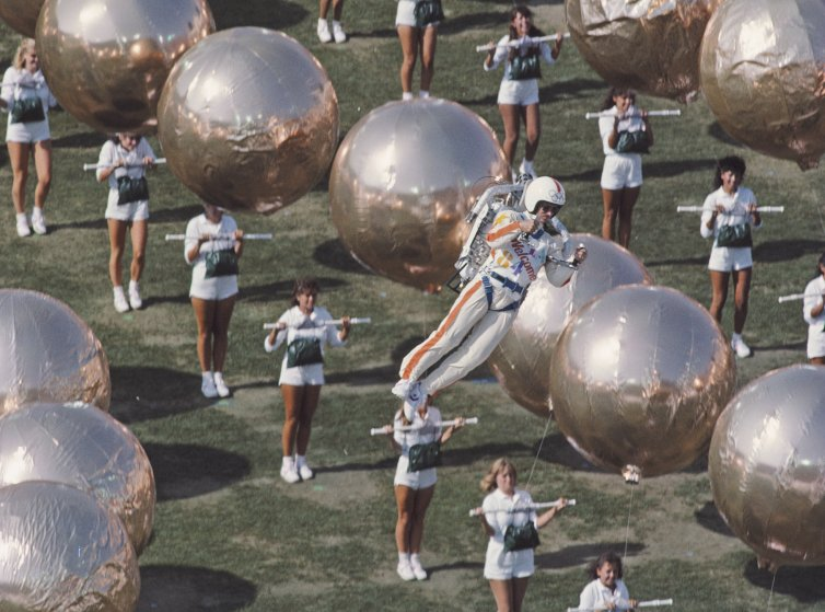 Los Angeles, 1984Bill Suitor hovers over the stadium by means of the Bell Aerosystems rocket pack.
