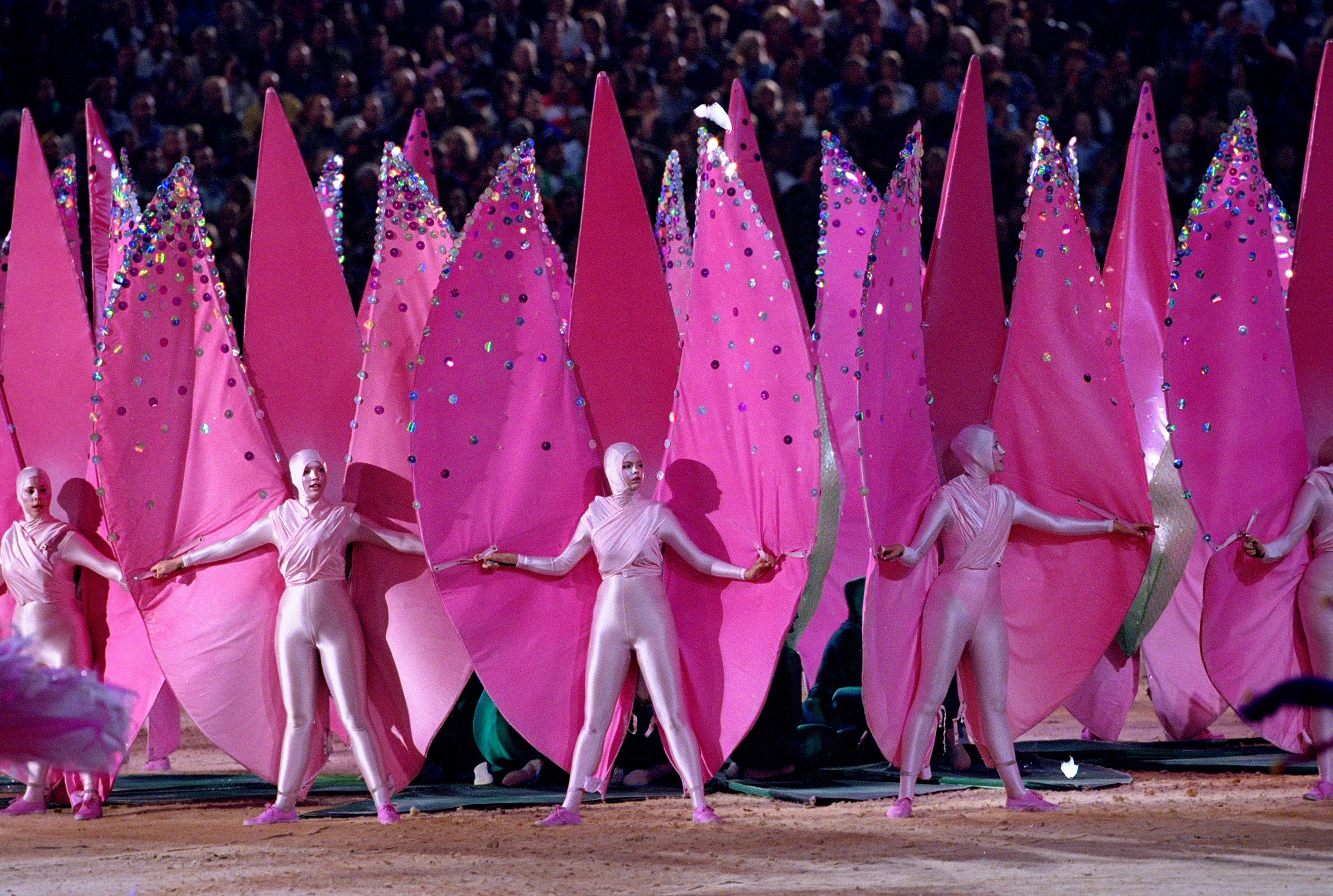 Sydney, 2000Performers dressed as pink petals step into formation to represent some of Australia's indigenous flowers.