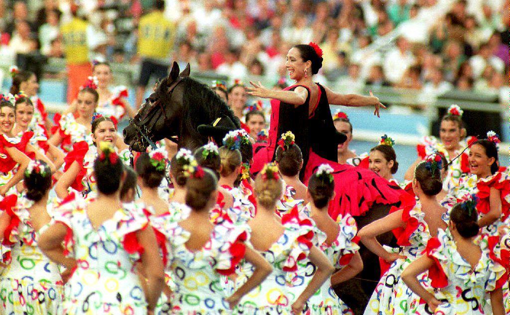 Barcelona, 1992Flamenco dancer Cristina Hoyos rides a horse as she passes through dancers.