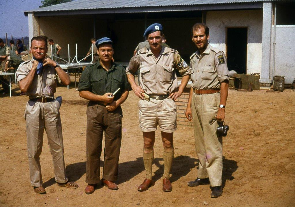 Comdt. Pat Quinlan, second from right, with the Norwegian pilot Bjorne Hovden, left, and Swedish co-pilot, right, of a U.N. helicopter that landed in Jadotville under heavy fire during the battle, in an attempt to deliver water to Irish troops. A Company's Swedish interpreter Lars Froberg is second from left.