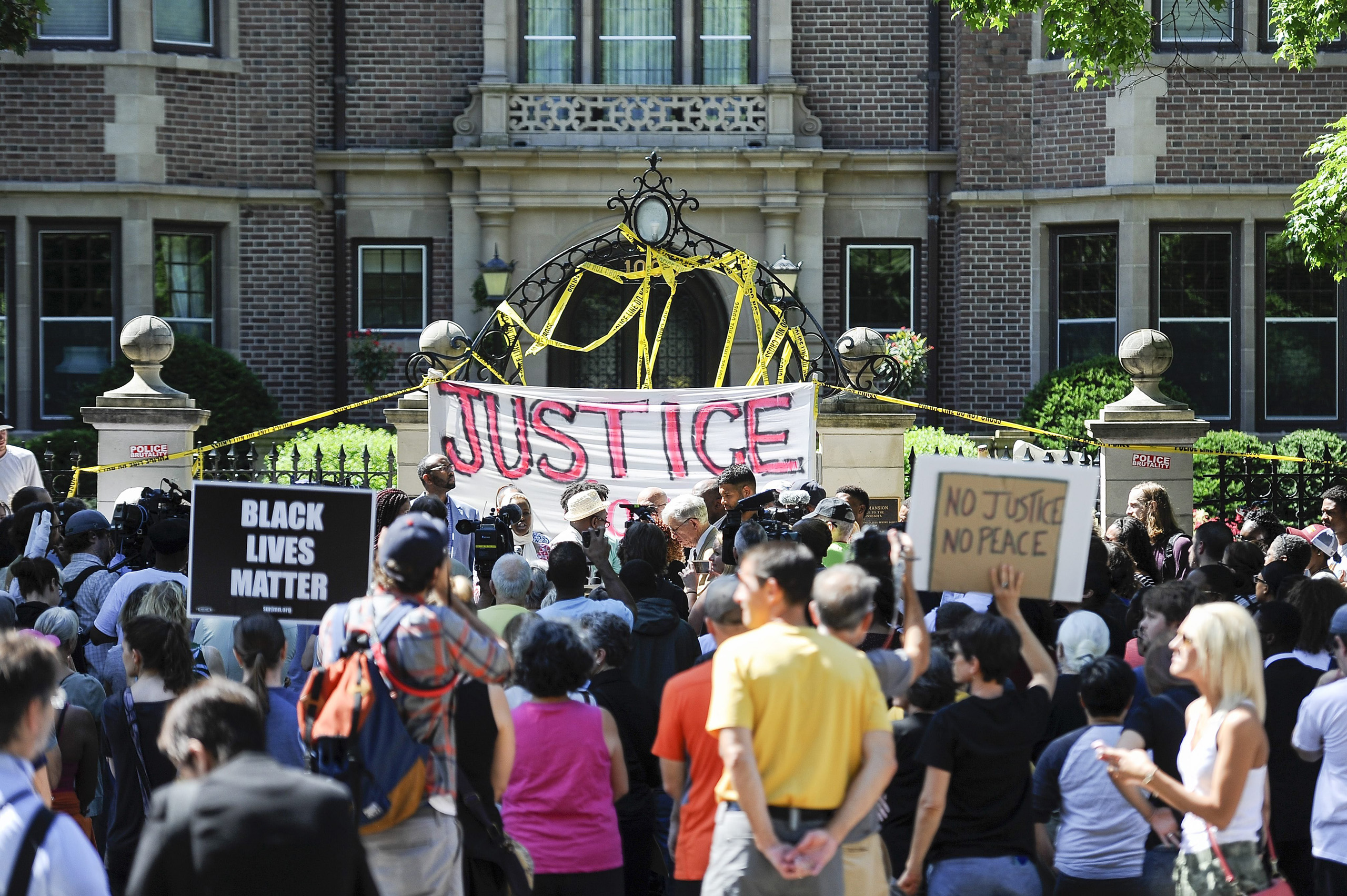 Protesters gather in front of the governor's residence in reaction to the the police shooting of Philando Castile in St. Paul, Minnesota, on July 7, 2016.