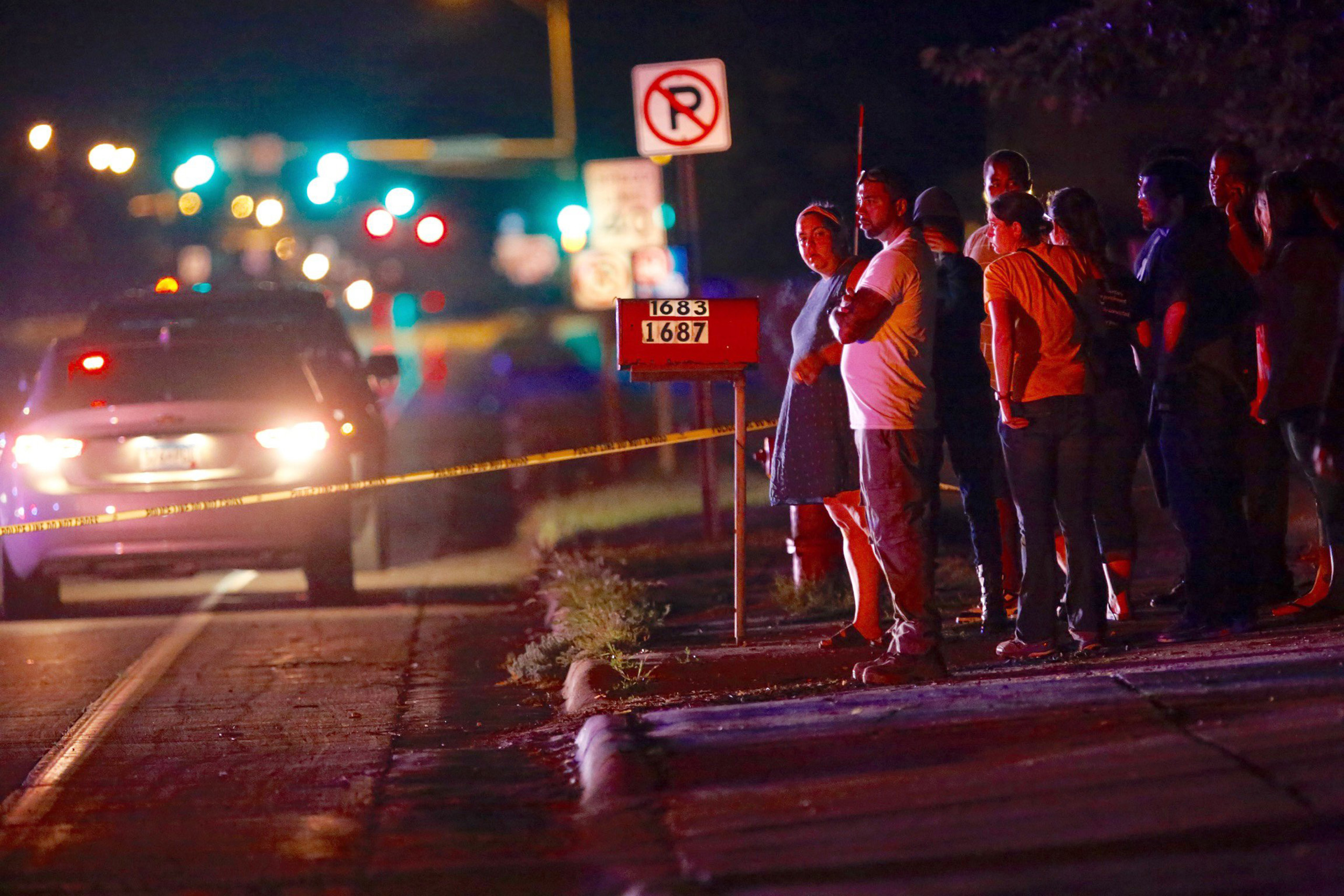 A crowd gathers at the scene of the shooting of Philando Castile by a St. Anthony Police officer in Falcon Heights, Minn. on July 6, 2016.