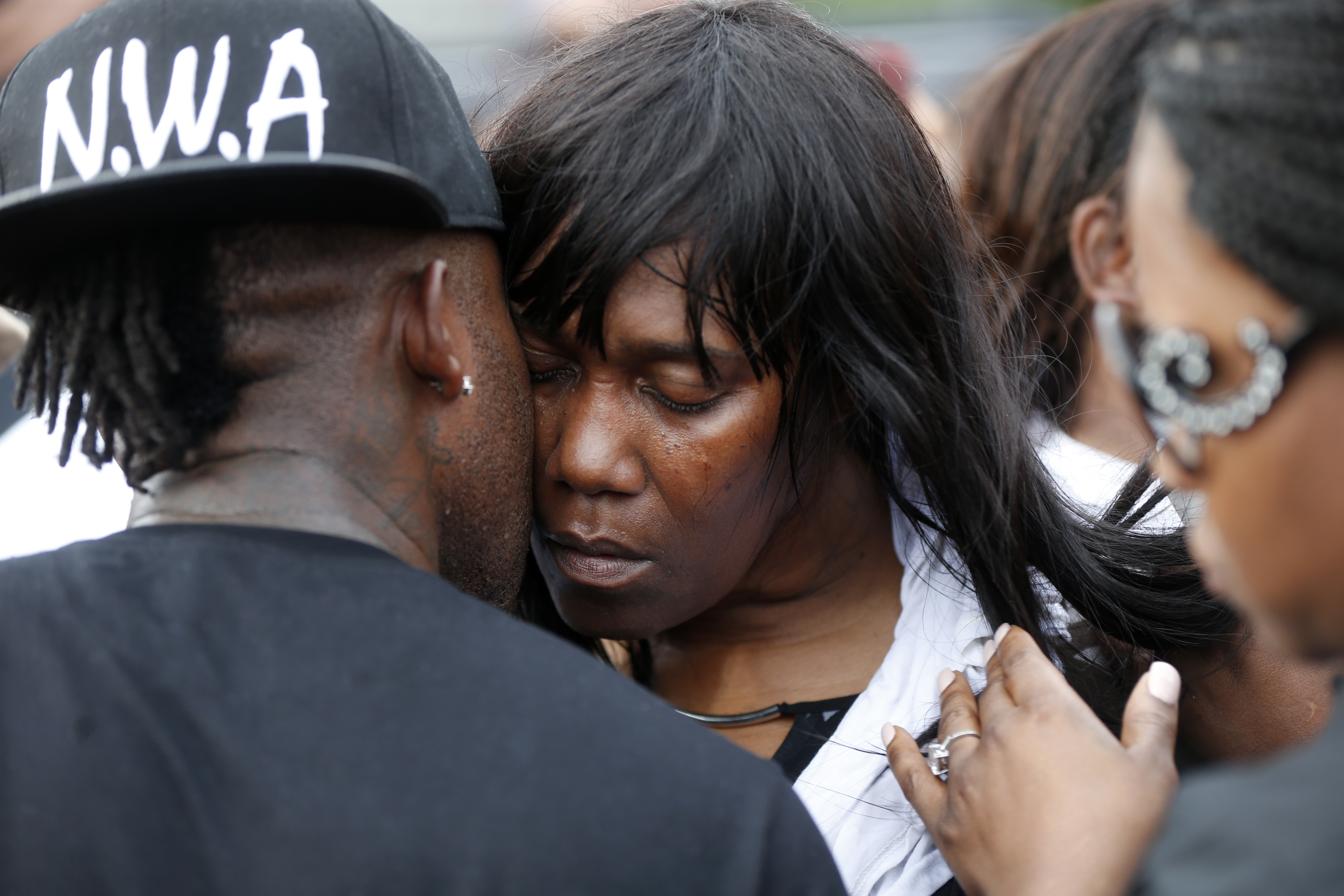 Sandra Sterling, aunt of Alton Sterling, is comforted at a vigil outside the Triple S convenience store in Baton Rouge, La., Wednesday, July 6, 2016