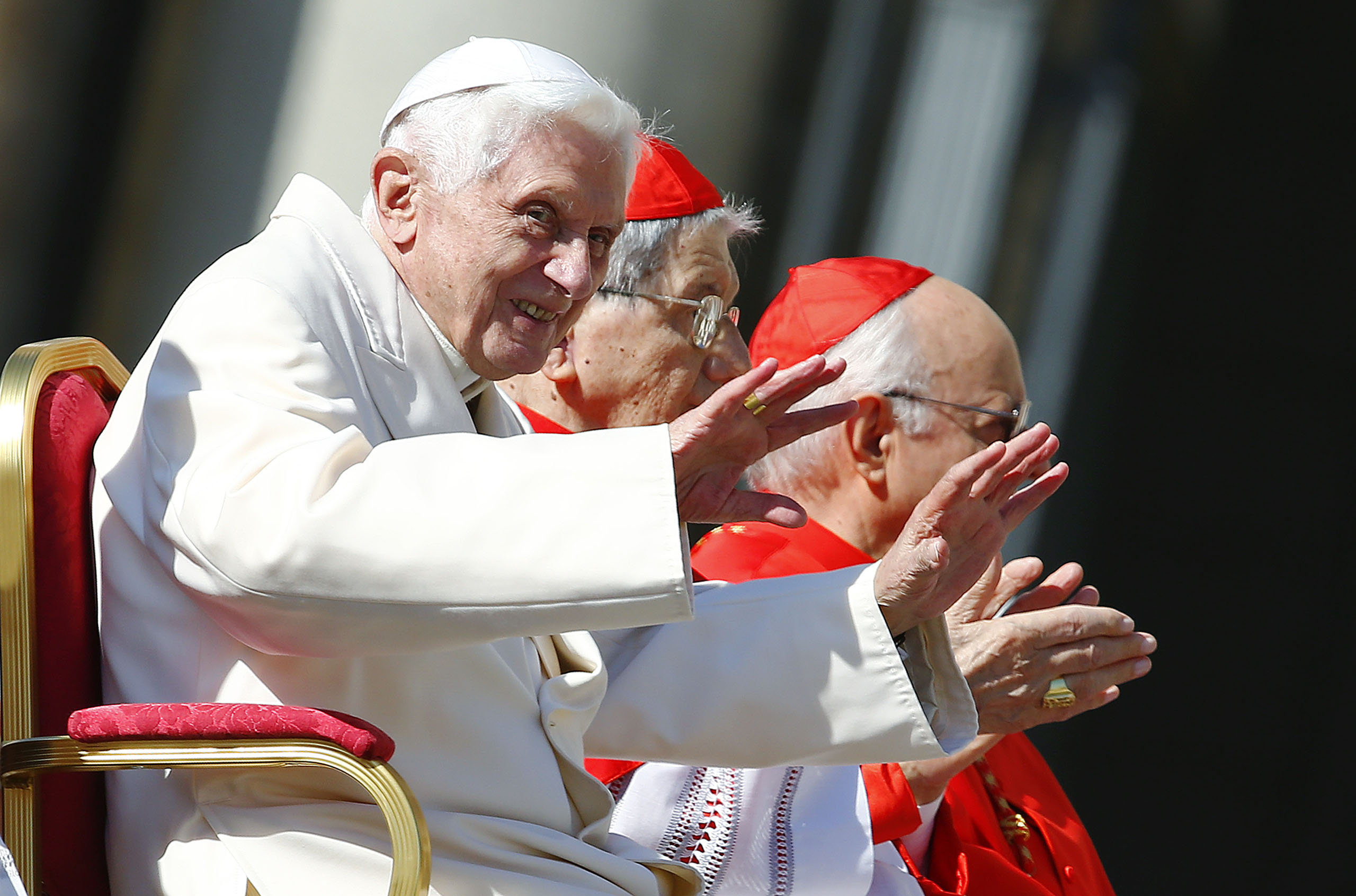 Emeritus Pope Benedict XVI waves before a mass in Saint Peter's square at the Vatican, Sept. 28, 2014.