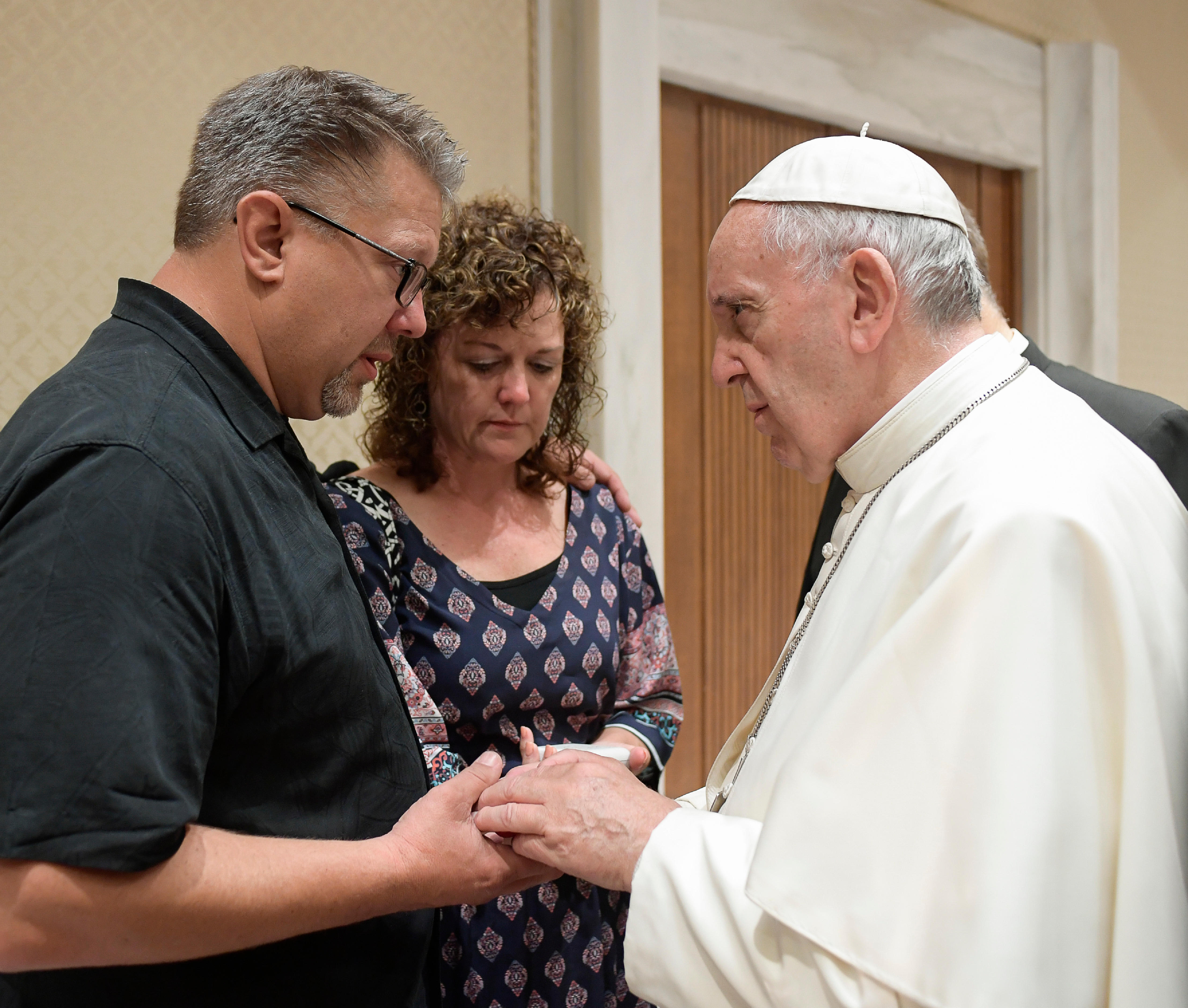 Pope Francis meets Nick, left, and Jodi Solomon, the parents of Beau Solomon, a U.S. college student whose body was found in Rome's Tiber river this week, during private encounter on Wednesday, July 6, 2016.