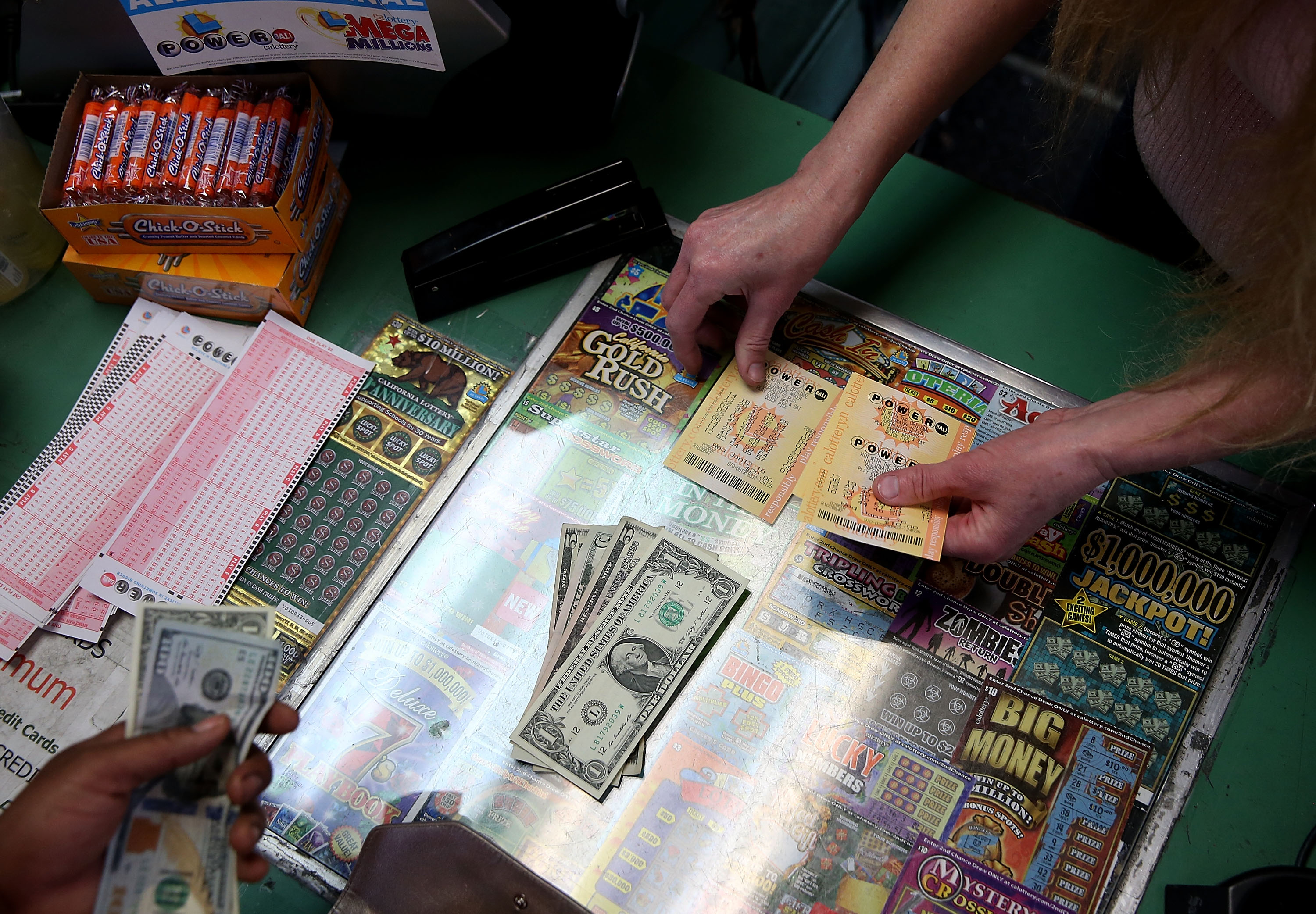 A customer buys Powerball tickets at Kavanagh Liquors on January 13, 2016 in San Lorenzo, California.
