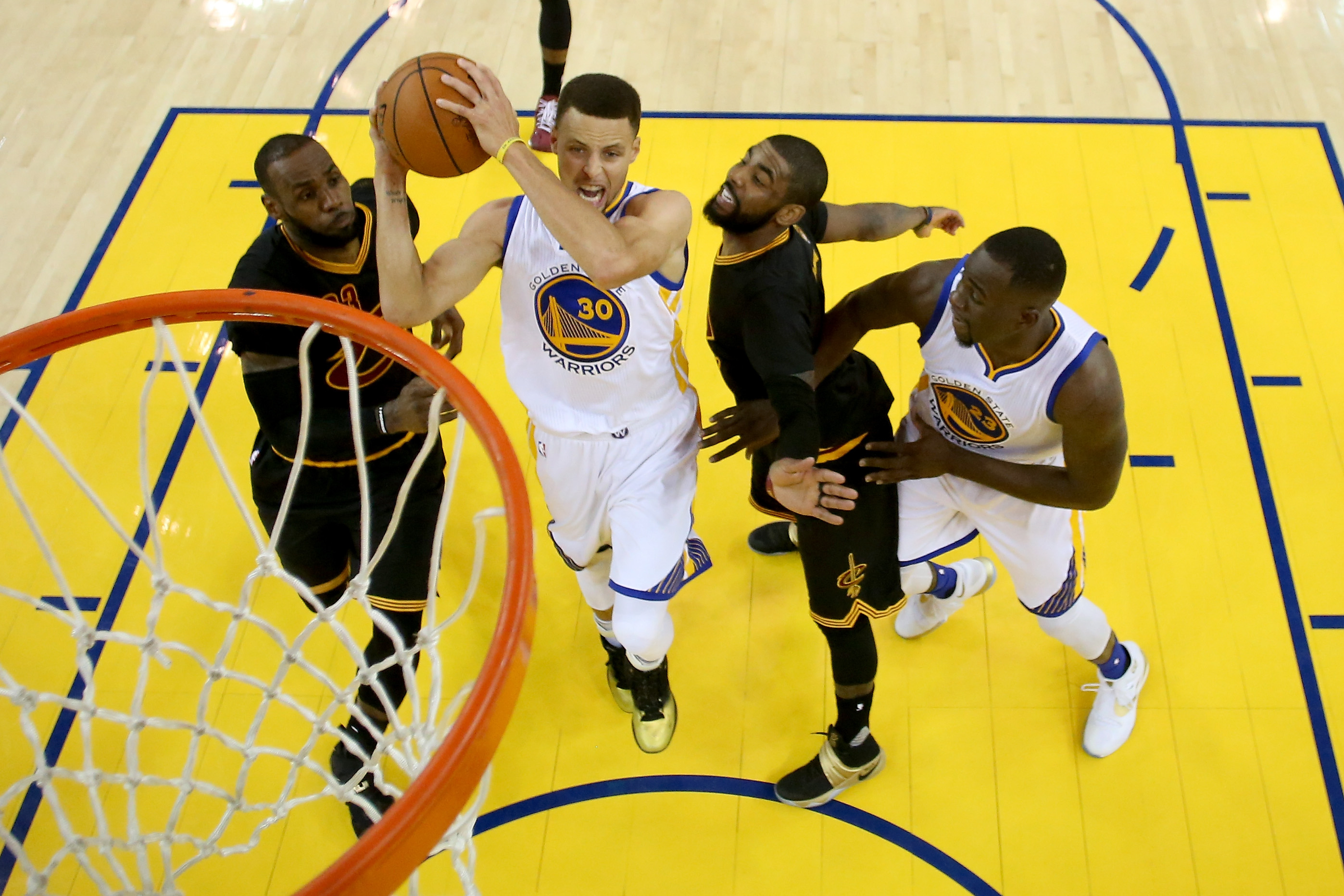 Stephen Curry #30 of the Golden State Warriors goes up for a shot against the Cleveland Cavaliers in Game 7 of the 2016 NBA Finals at ORACLE Arena on June 19, 2016 in Oakland, California.