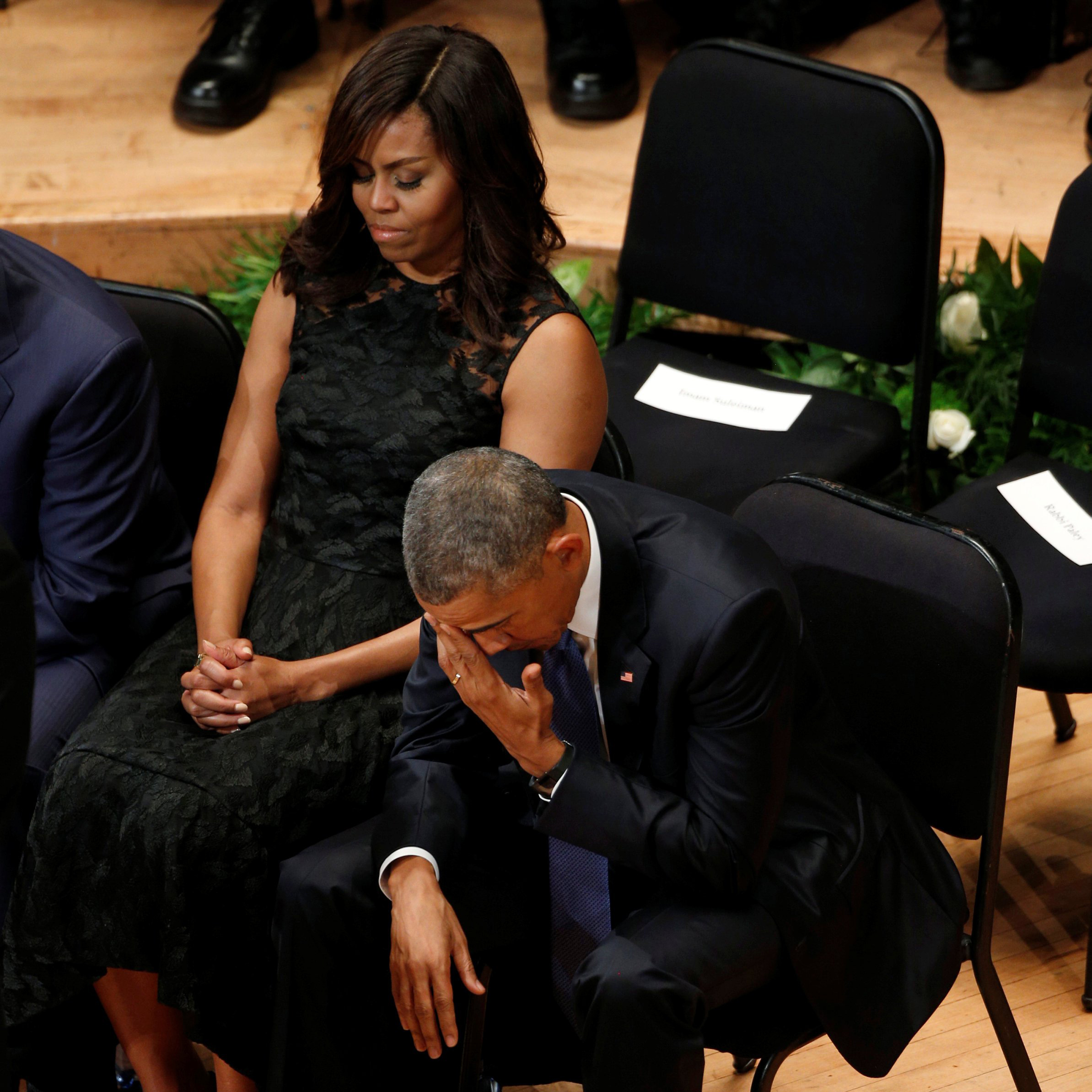 President Barack Obama and first lady Michelle Obama attend a memorial service on July 12, 2016 for five policemen killed last week in an attack in Dallas.