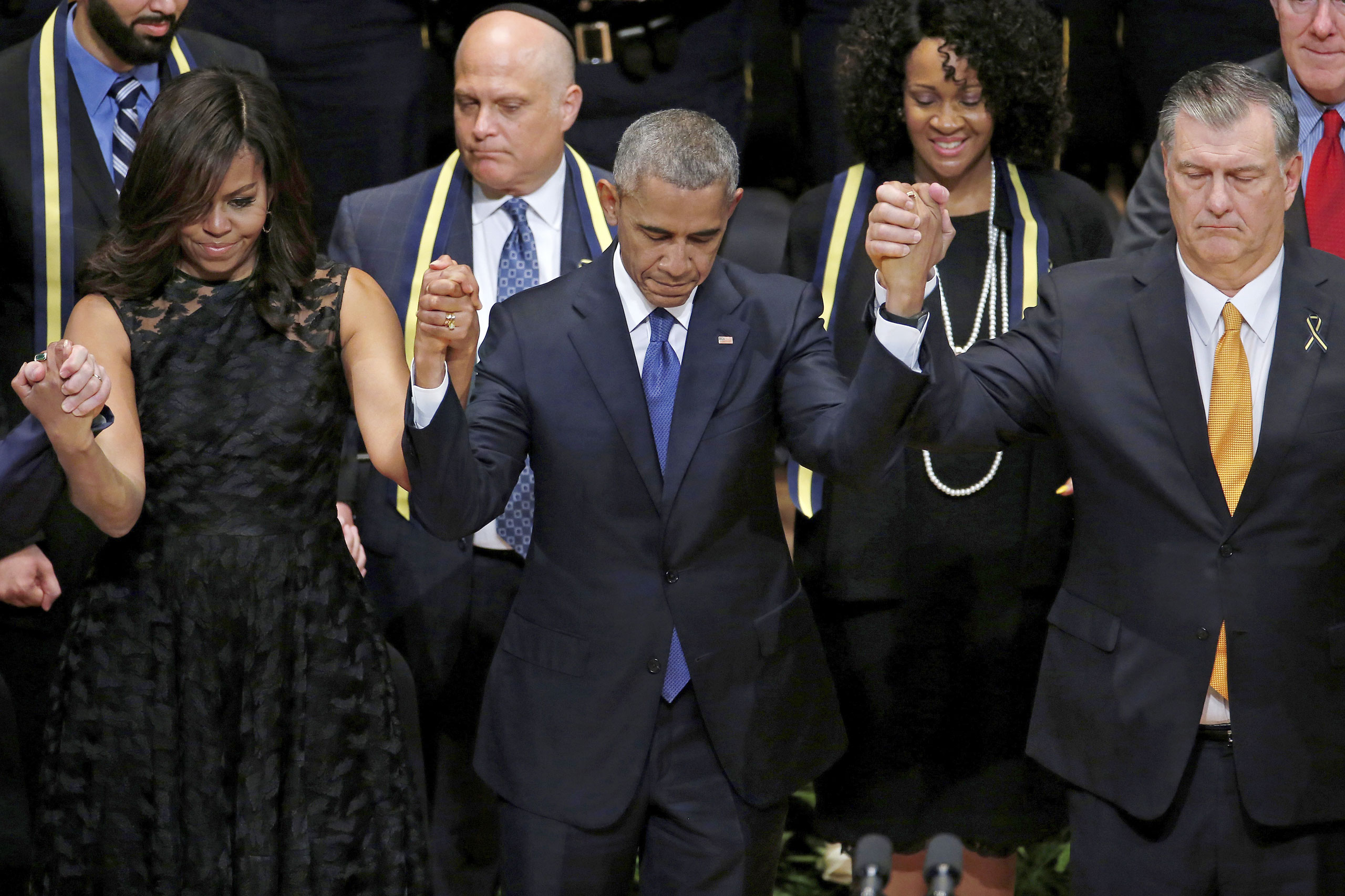 "At a service for the five Dallas police officers killed on July 8, President Obama, with Michelle Obama and Dallas Mayor Mike Rawlings, said he had ""spoken at too many memorials"""