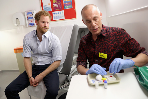 Prince Harry waits for the results of an HIV test taken by Specialist Psychotherapist Robert Palmer as visits Burrell Street Sexual Health Clinic on July 14, 2016 in London, England.
