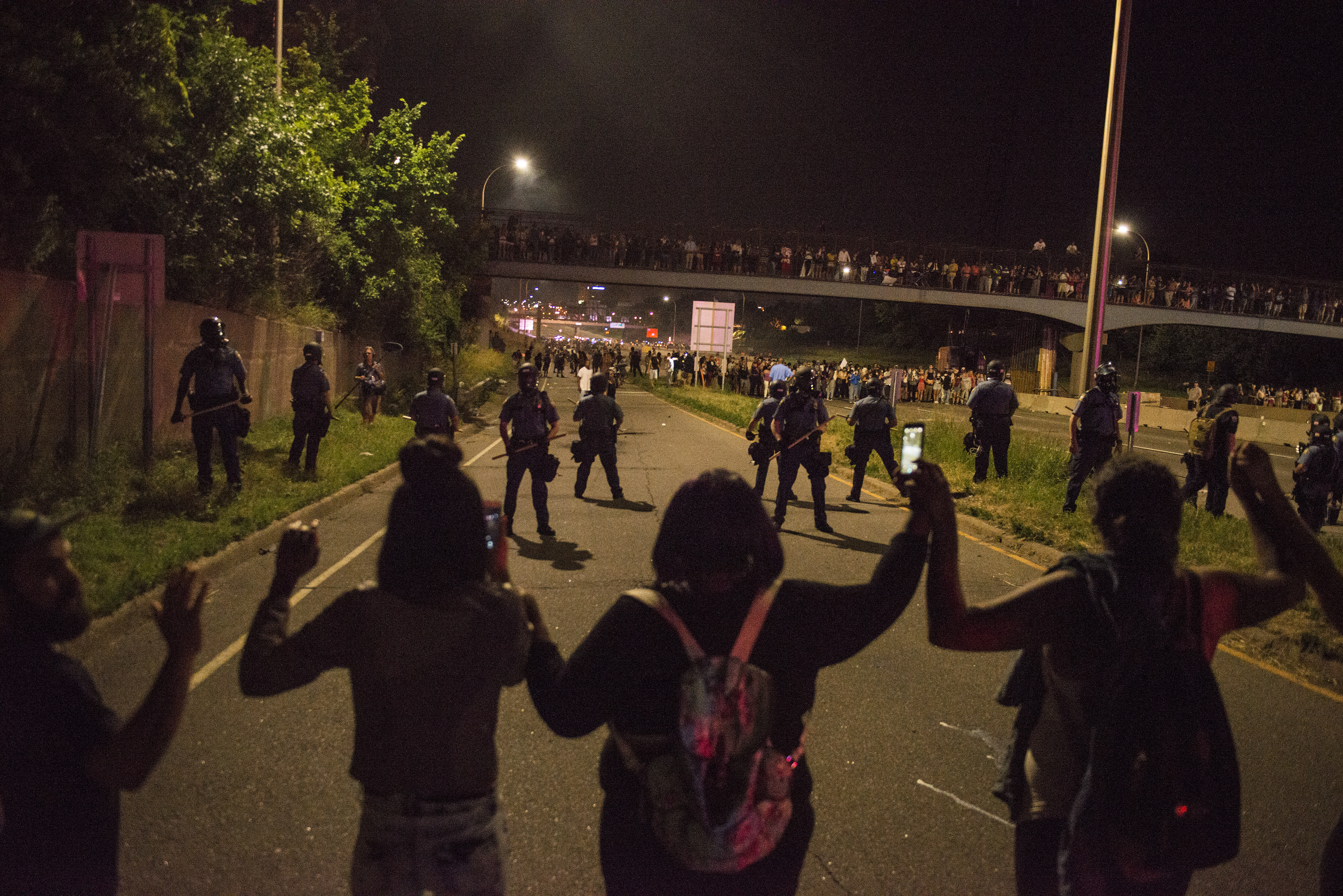 Protesters link hands on shut down highway I-94 on July 9, 2016 in St. Paul, Minnesota, in response to the police killing of Philando Castile on June 6, 2016 in Falcon Heights, Minnesota.