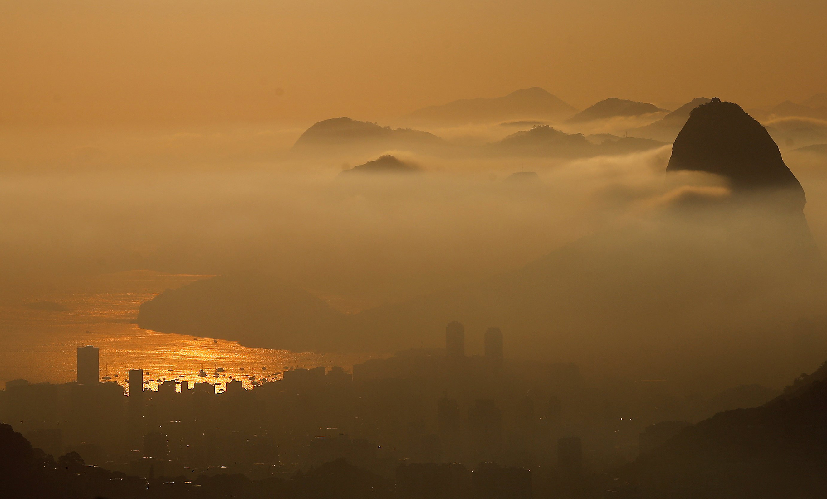 Sugarloaf Mountain is seen from the Vista Chinesa (Chinese View) during sunrise in Rio de Janeiro on May 4, 2016.
