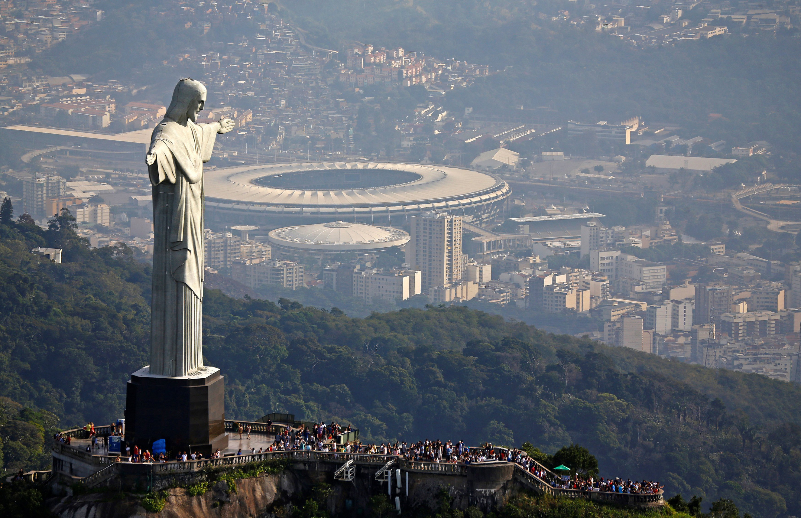 An aerial view shows Christ the Redeemer atop the Corcovado mountain in Rio de Janeiro on July 16, 2016.