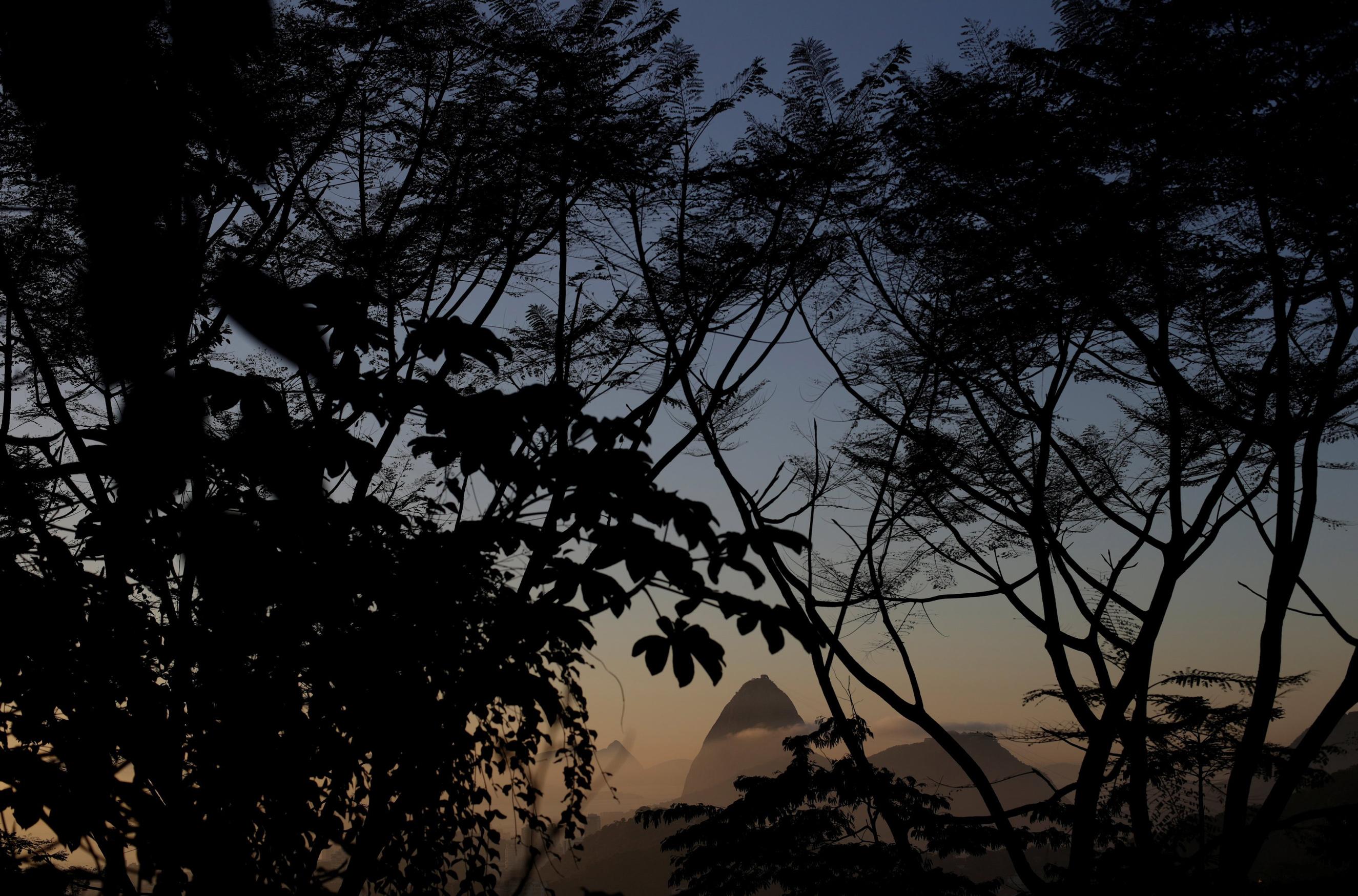 Sugarloaf Mountain is seen from the Santa Teresa neighbourhood during sunrise in Rio de Janeiro on June 16, 2016.