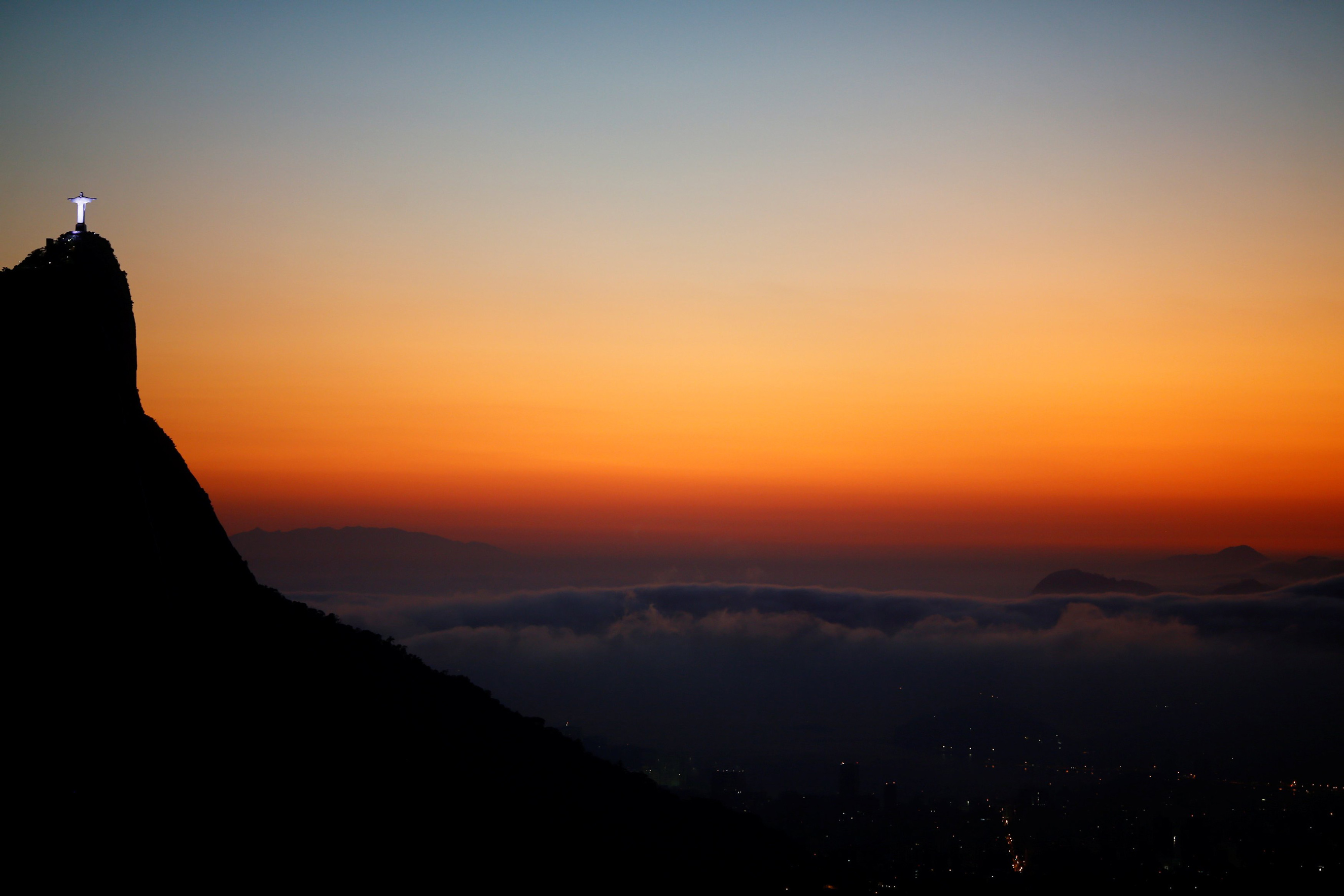 Christ the Redeemer is seen from the Vista Chinesa (Chinese View) during sunrise in Rio de Janeiro on May 4, 2016.