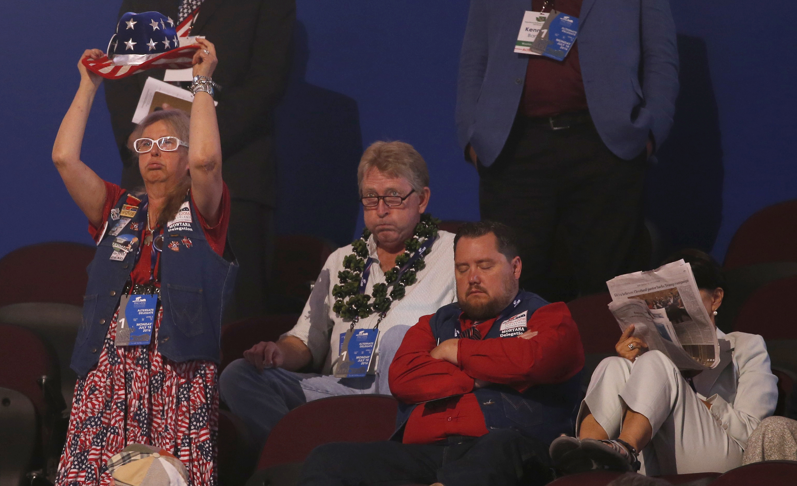 Alternate delegates and visitors watch with a variety of expression at the Republican National Convention in Cleveland, Ohio, on July 18, 2016.