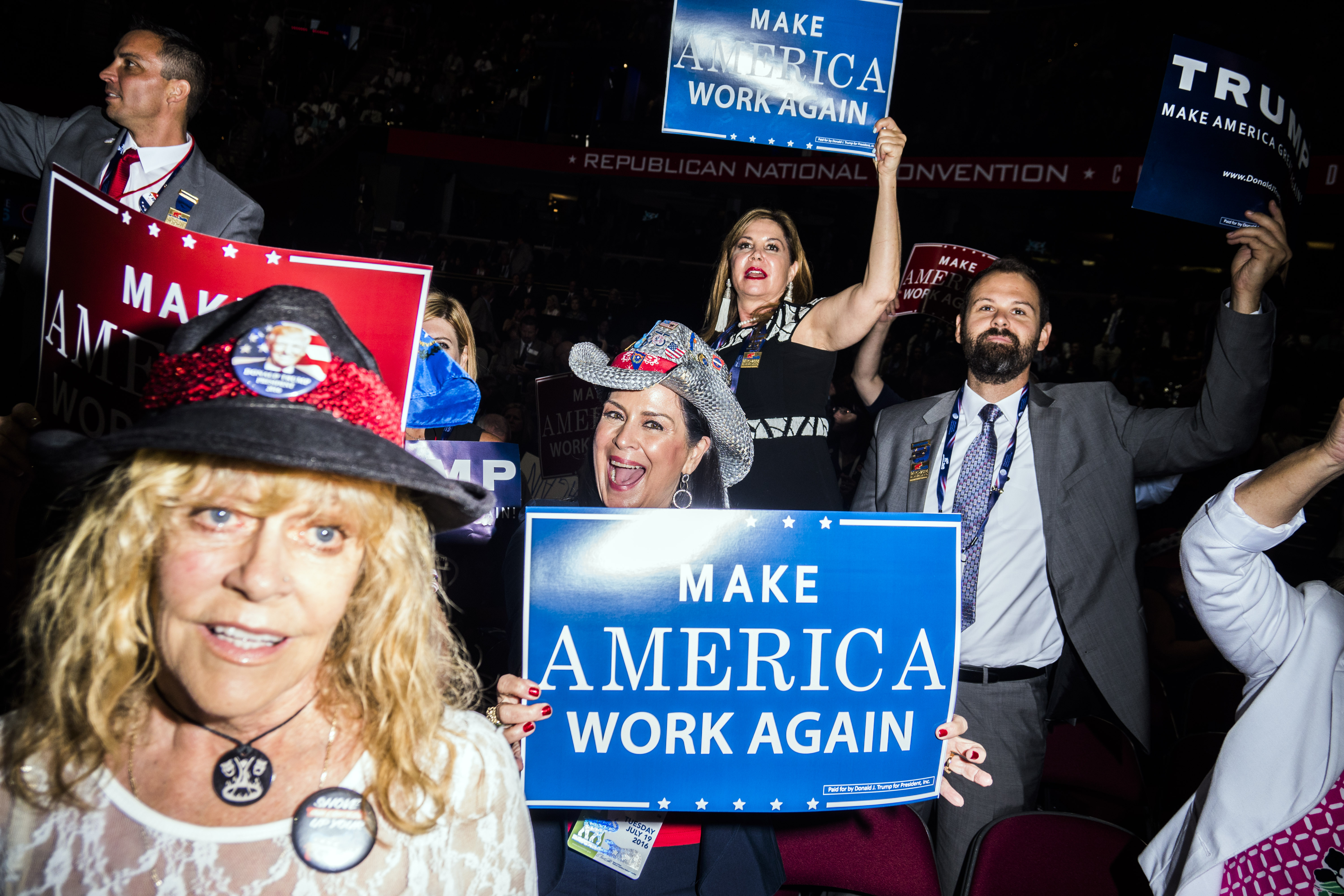 Attendees hold signs at the Republican National Convention in Cleveland on July 19, 2016.