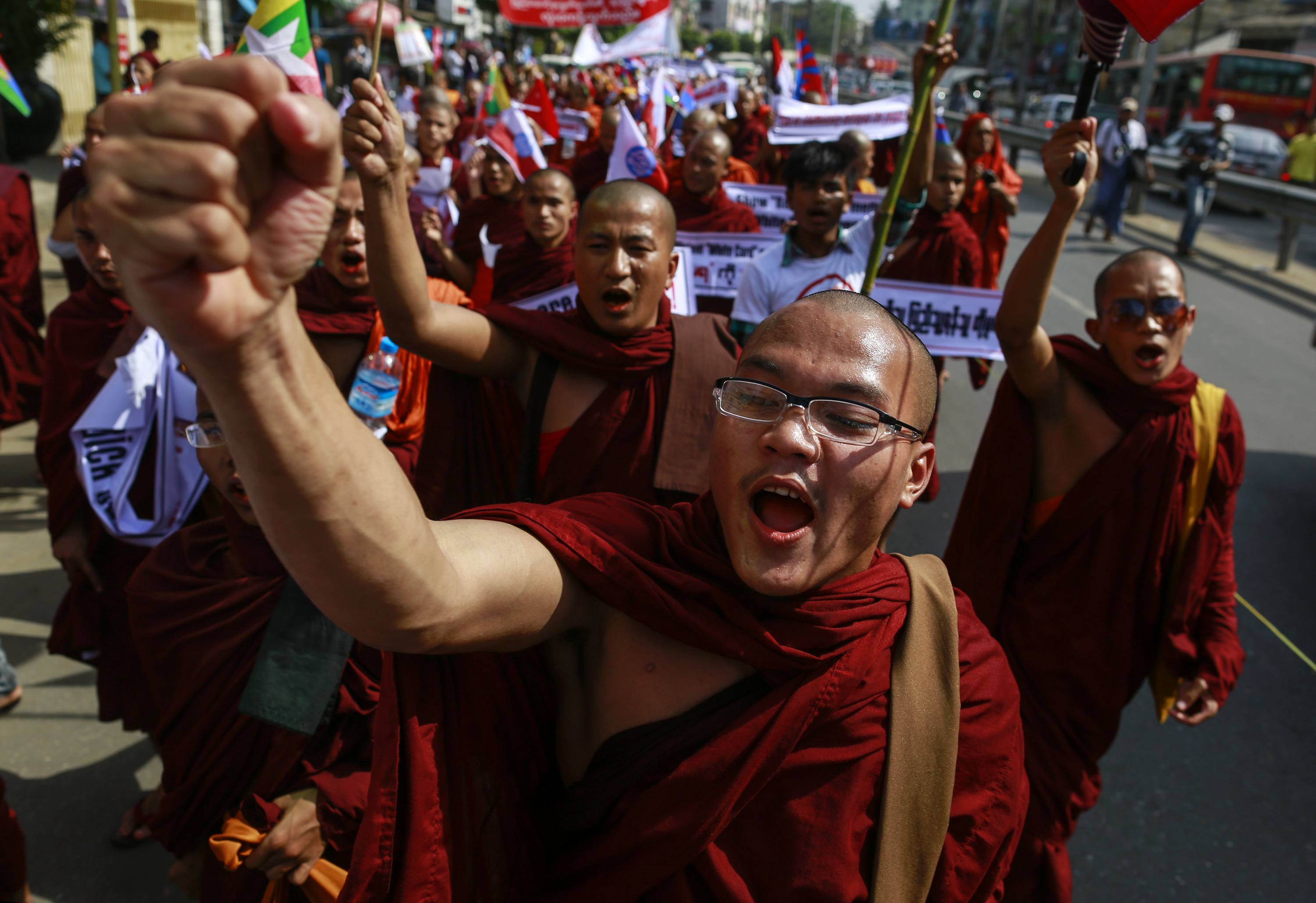 Buddhist monks and other people take part in a protest to demand the revocation of the right of holders of temporary identification cards to vote in Rangoon, Burma, on Feb. 11, 2015