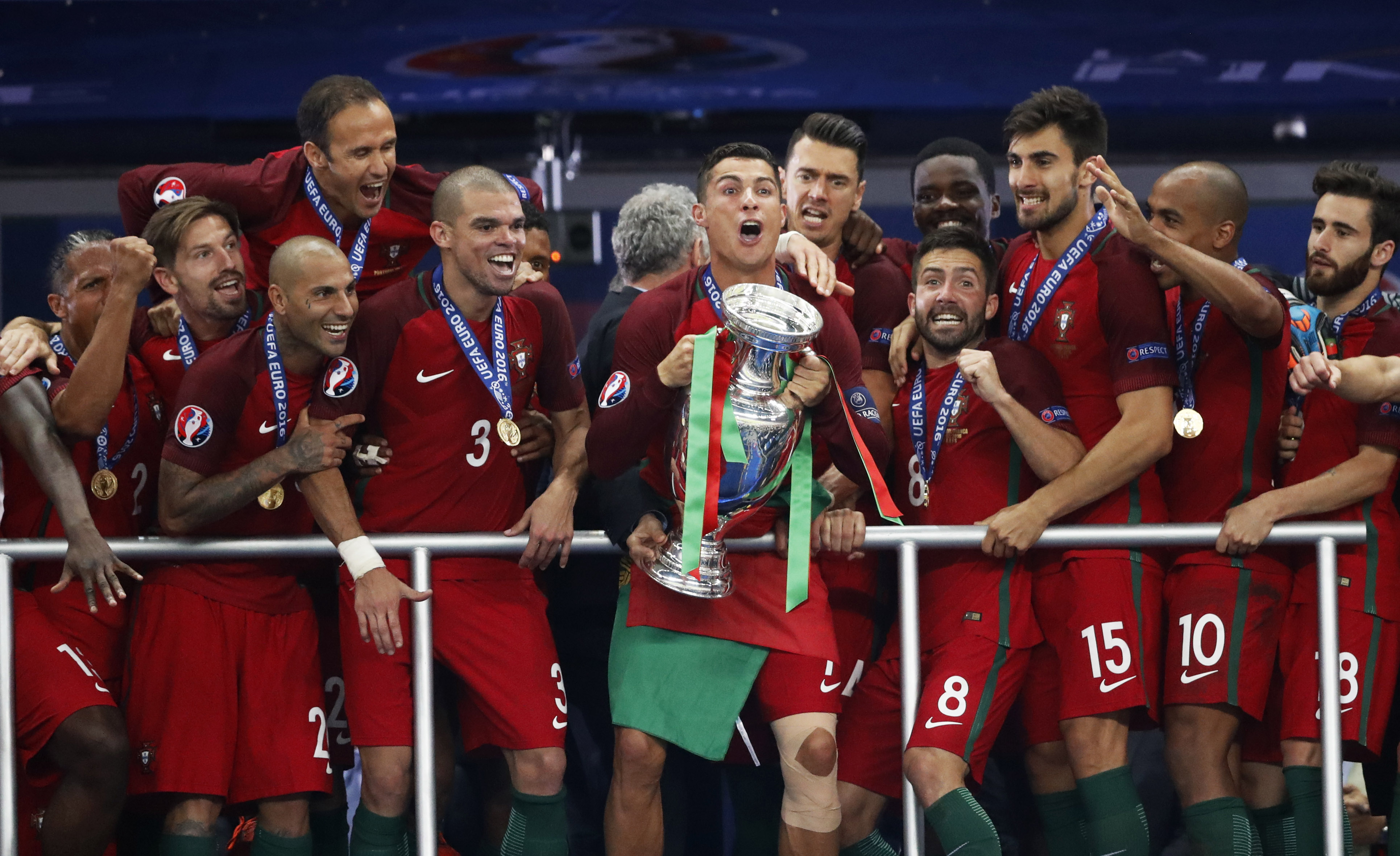 Portugal's Cristiano Ronaldo celebrates with team mates and the trophy after Portugal beat hosts France to win Euro 2016 at the Stade de France, Saint-Denis, near Paris on July 10, 2016.