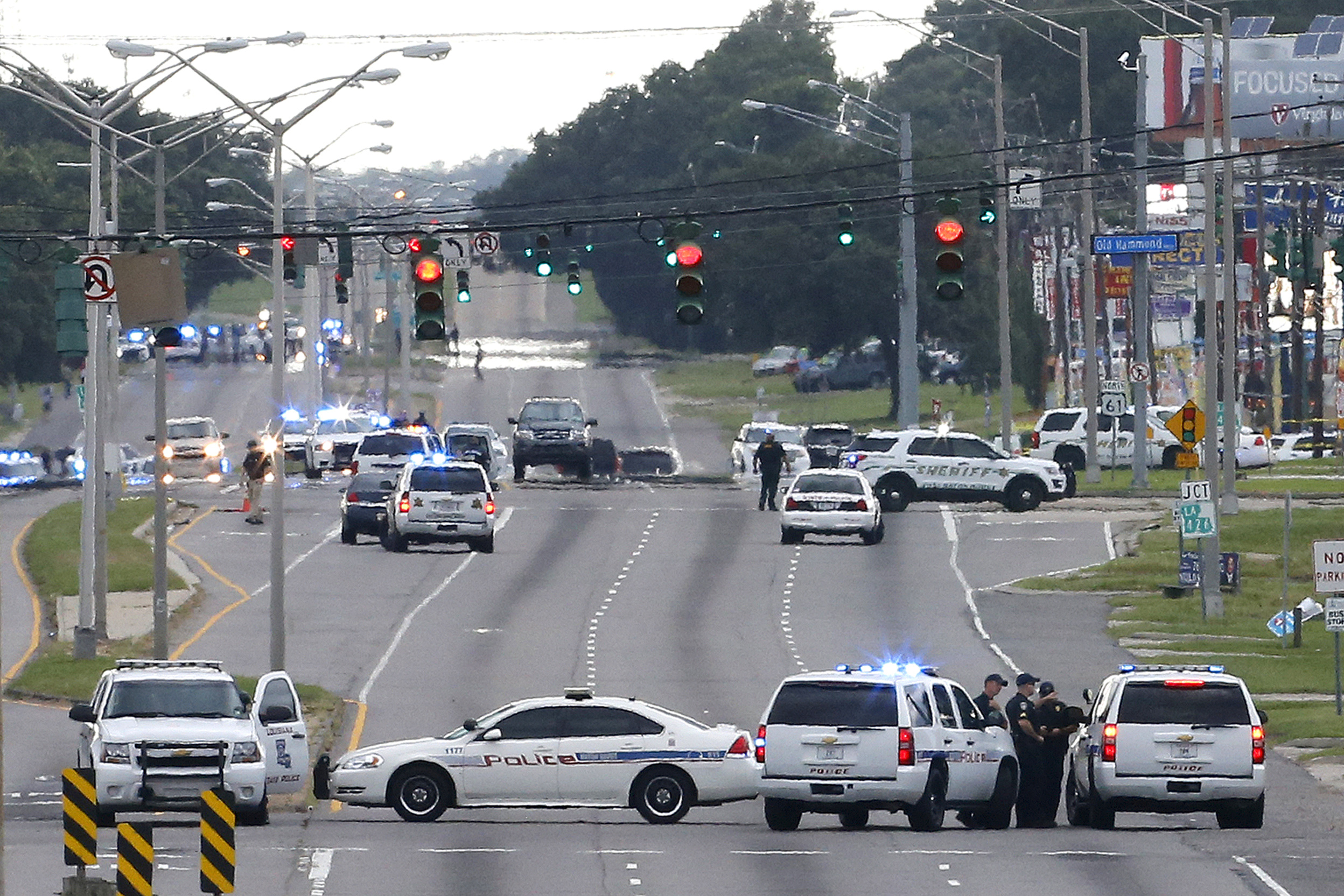 Law enforcement vehicles block access to Airline Highway near the scene of a fatal shooting of police officers in Baton Rouge, Louisiana, U.S., July 17, 2016.