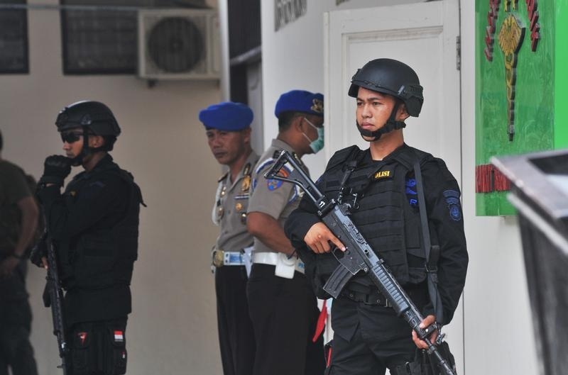 Indonesian security forces stand guard at the hospital where a body believed to be that of the country's most-wanted militant, Santoso, is lying in Central Sulawesi, Indonesia, on July 19, 2016