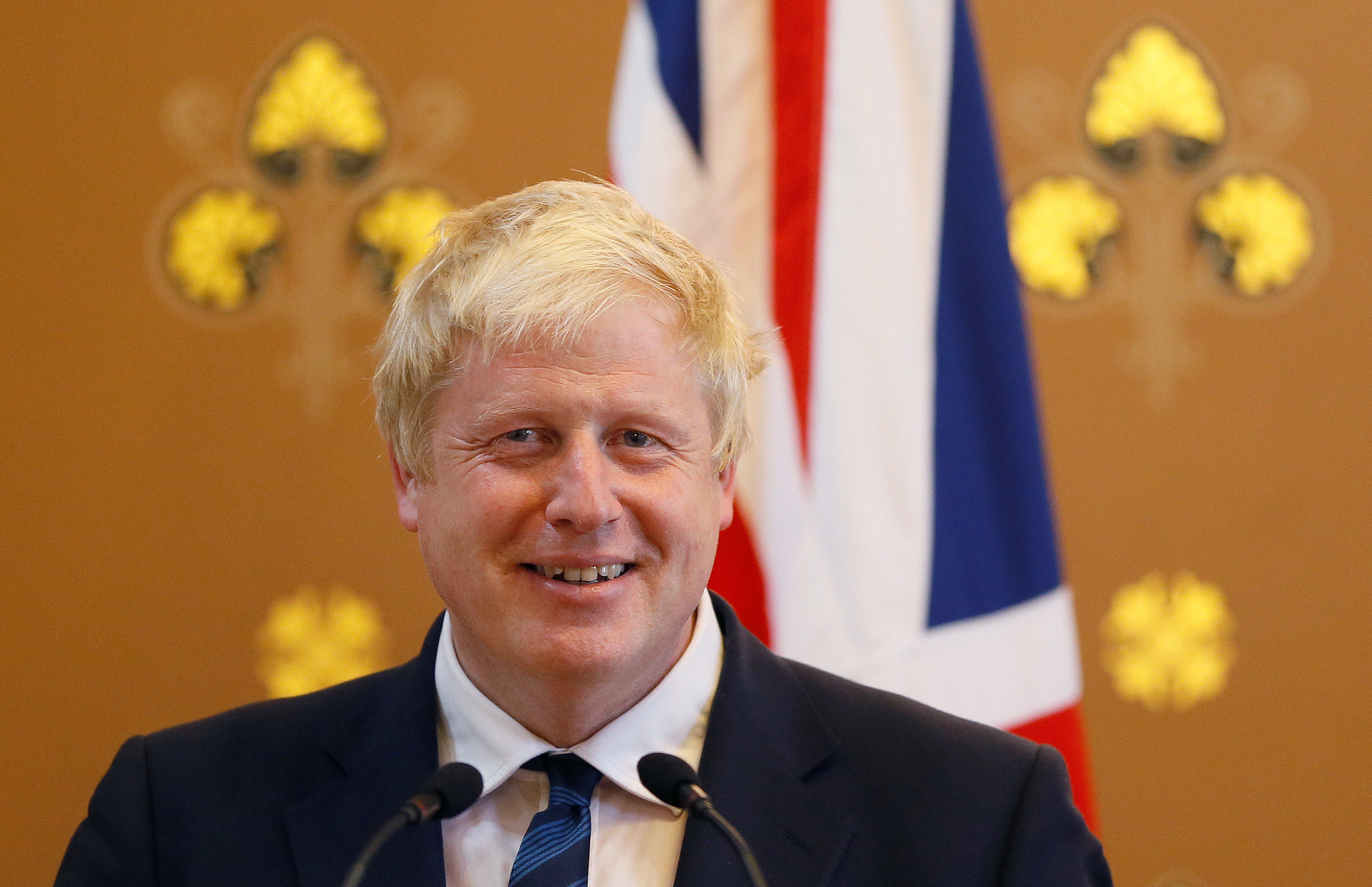 Britain's Foreign Secretary Boris Johnson smiles during a press conference with U.S. Secretary of State John Kerry at the Foreign Office in London, July 19, 2016