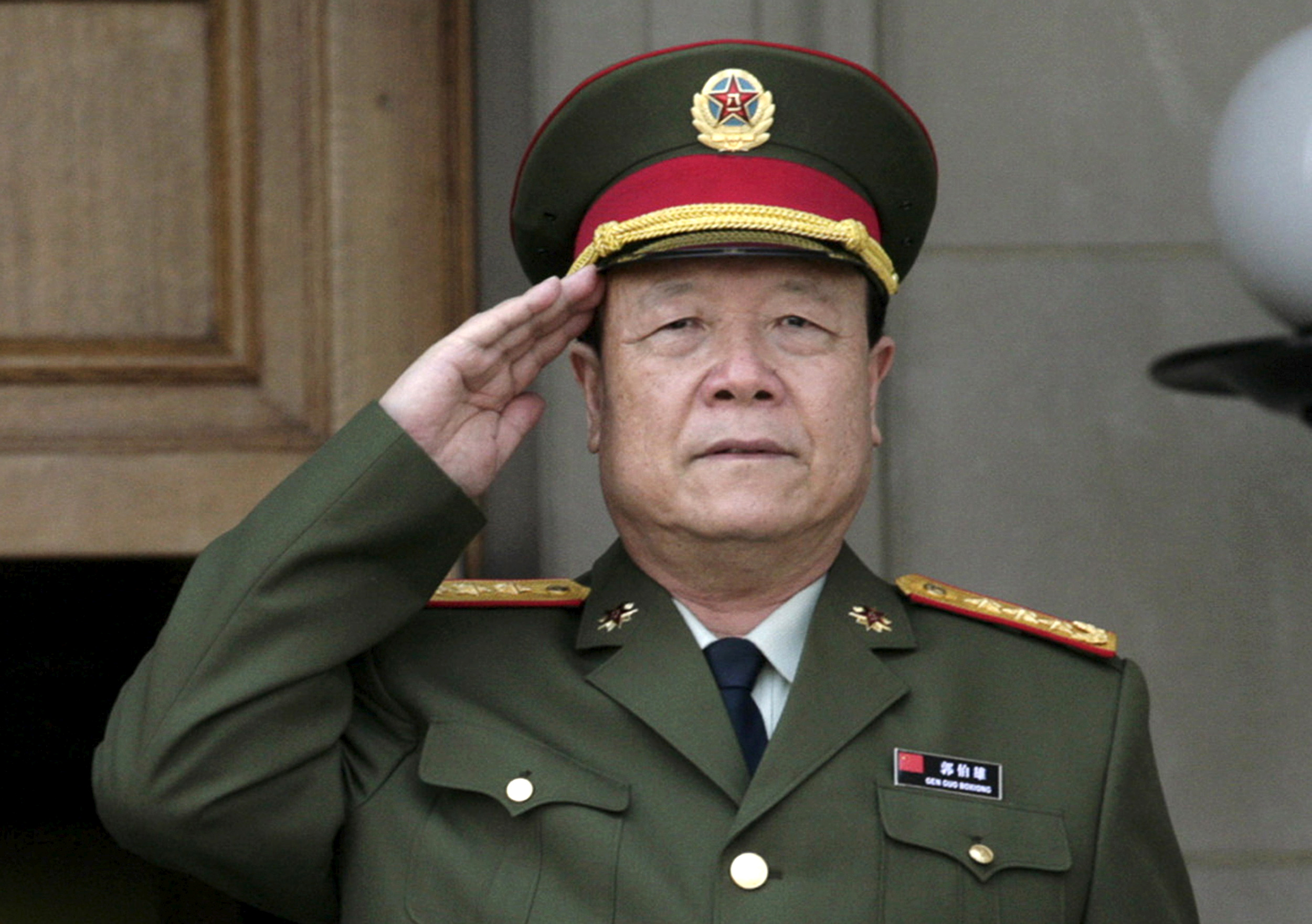 China's then Central Military Commission former Vice Chairman General Guo Boxiong stands at attention during the playing of the national anthem before a meeting at the Pentagon in Washington in this July 18, 2006 file photo.