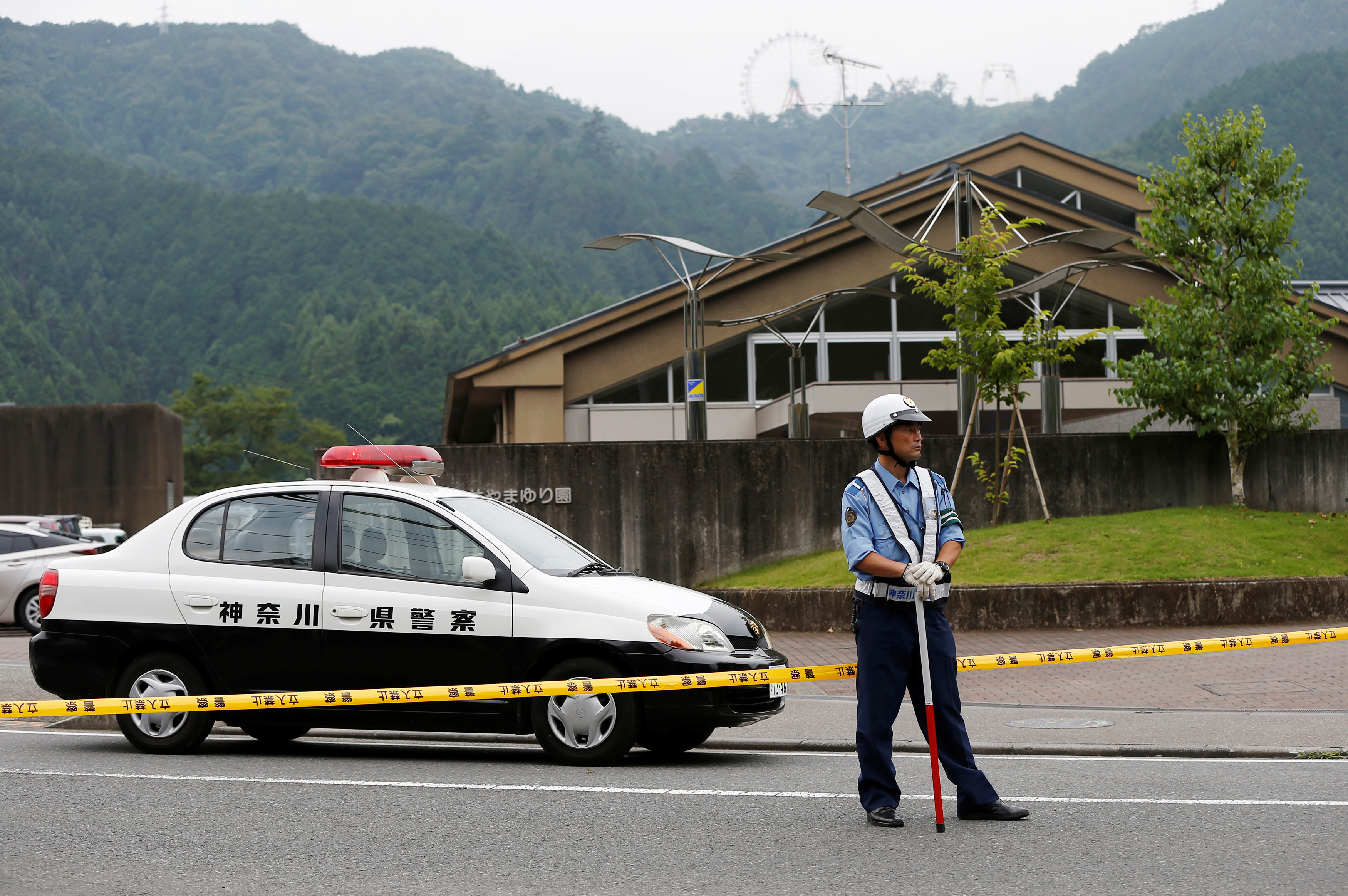 A police officer stands guard in front of a facility for the disabled, where a deadly attack by a knife-wielding man took place, in Sagamihara, Kanagawa prefecture, Japan, July 26, 2016.