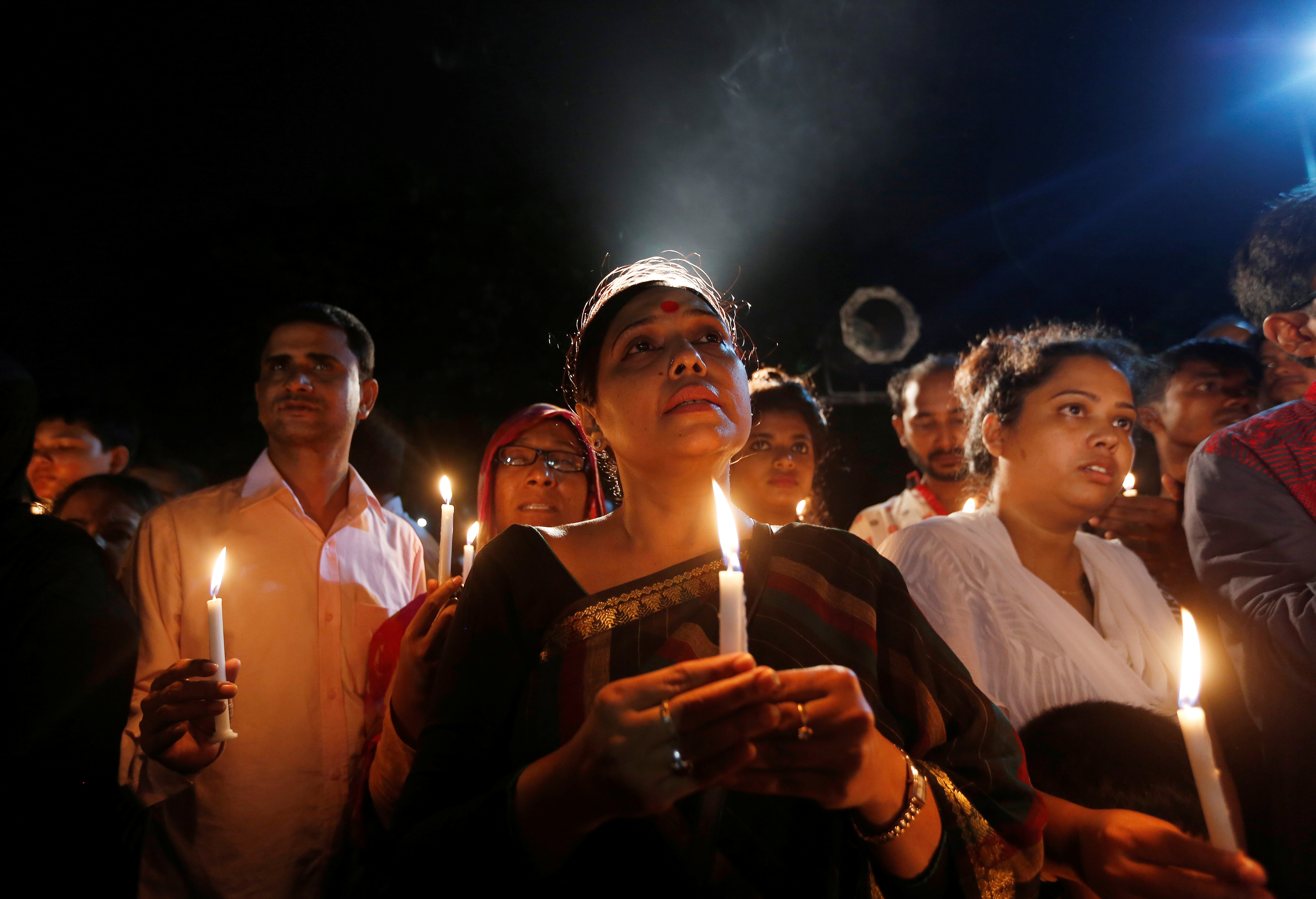 People attend a candlelight vigil for the victims of the attack on the Holey Artisan Bakery restaurant in Dhaka, Bangladesh, on July 3, 2016