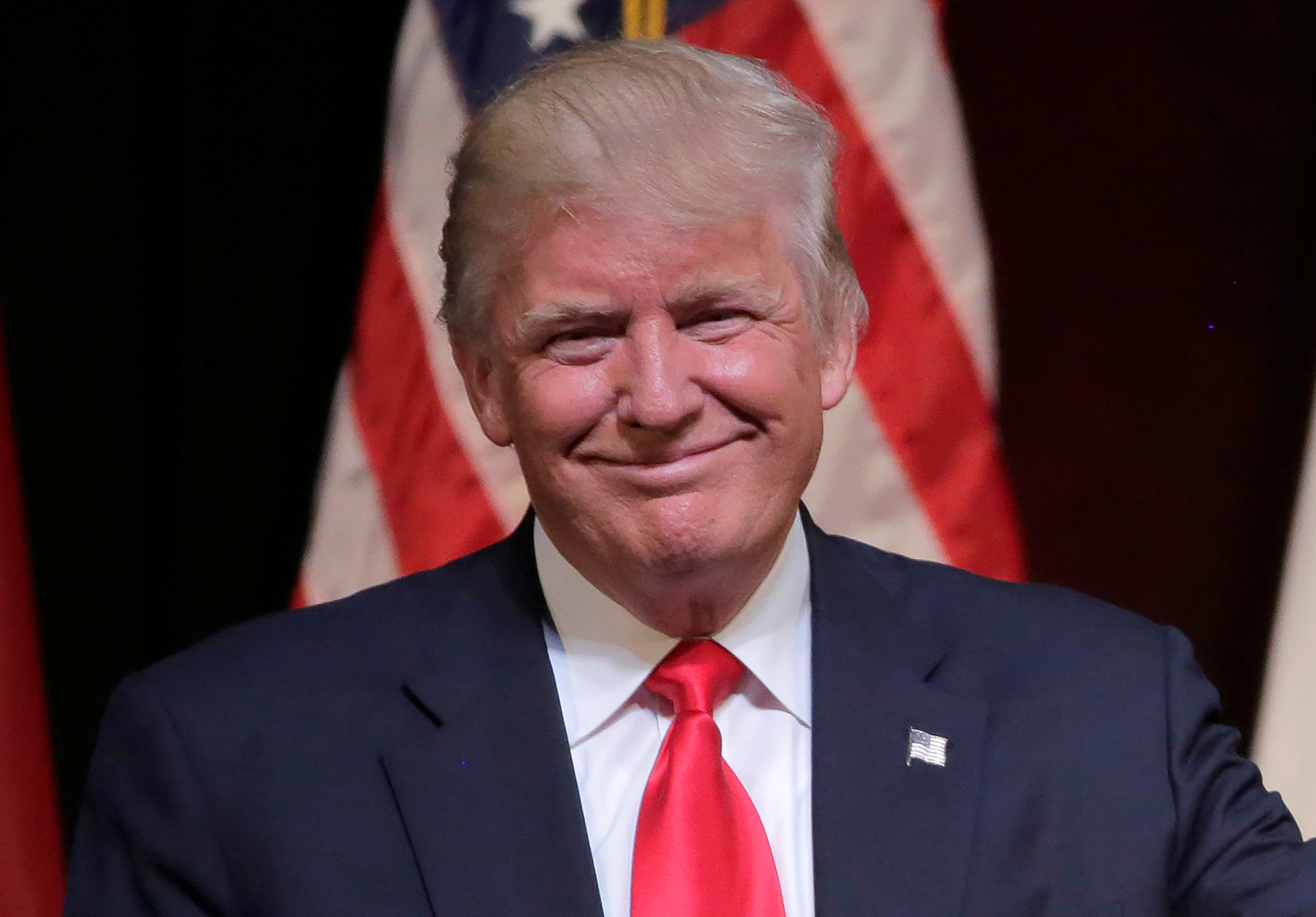 Republican presidential candidate Donald Trump smiles at a campaign rally in Raleigh, North Carolina, U.S., July 5, 2016.