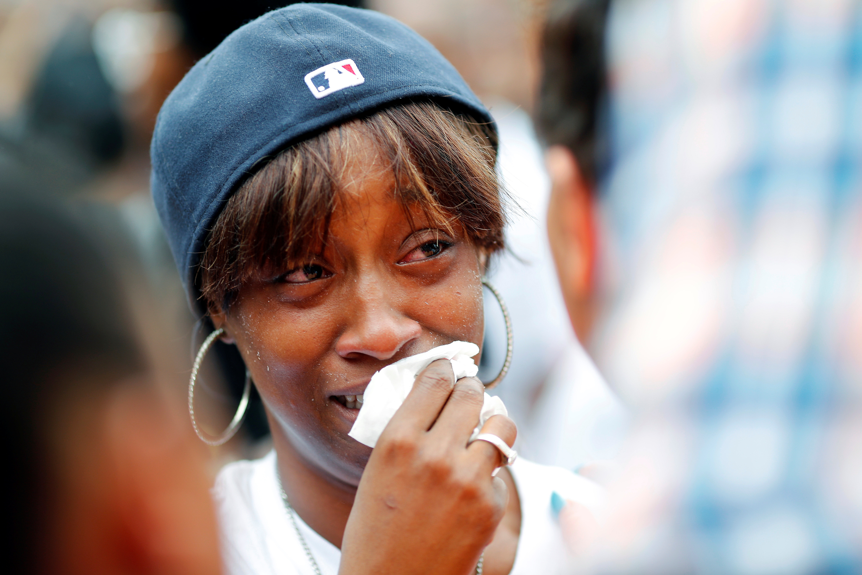 Diamond Reynolds, girlfriend of Philando Castile gets a hug as people gather to protest the fatal shooting of by Minneapolis area police during a traffic stop on Wednesday, in St. Paul, Minnesota, July 7, 2016.
