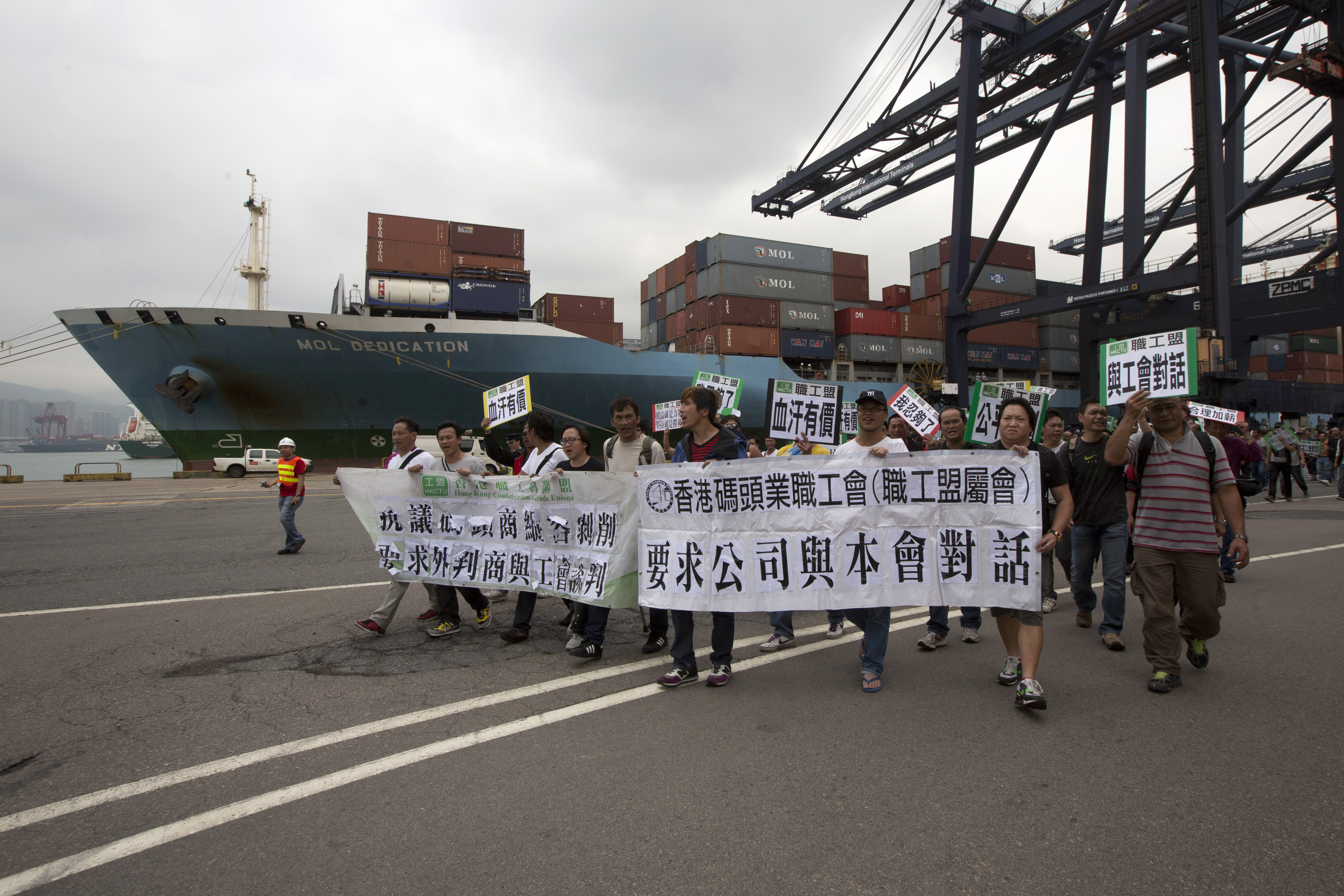 Dockworkers march during a strike at Kwai Chung container terminal, which is operated by Hong Kong International Terminals Ltd., in Hong Kong on March 29, 2013
