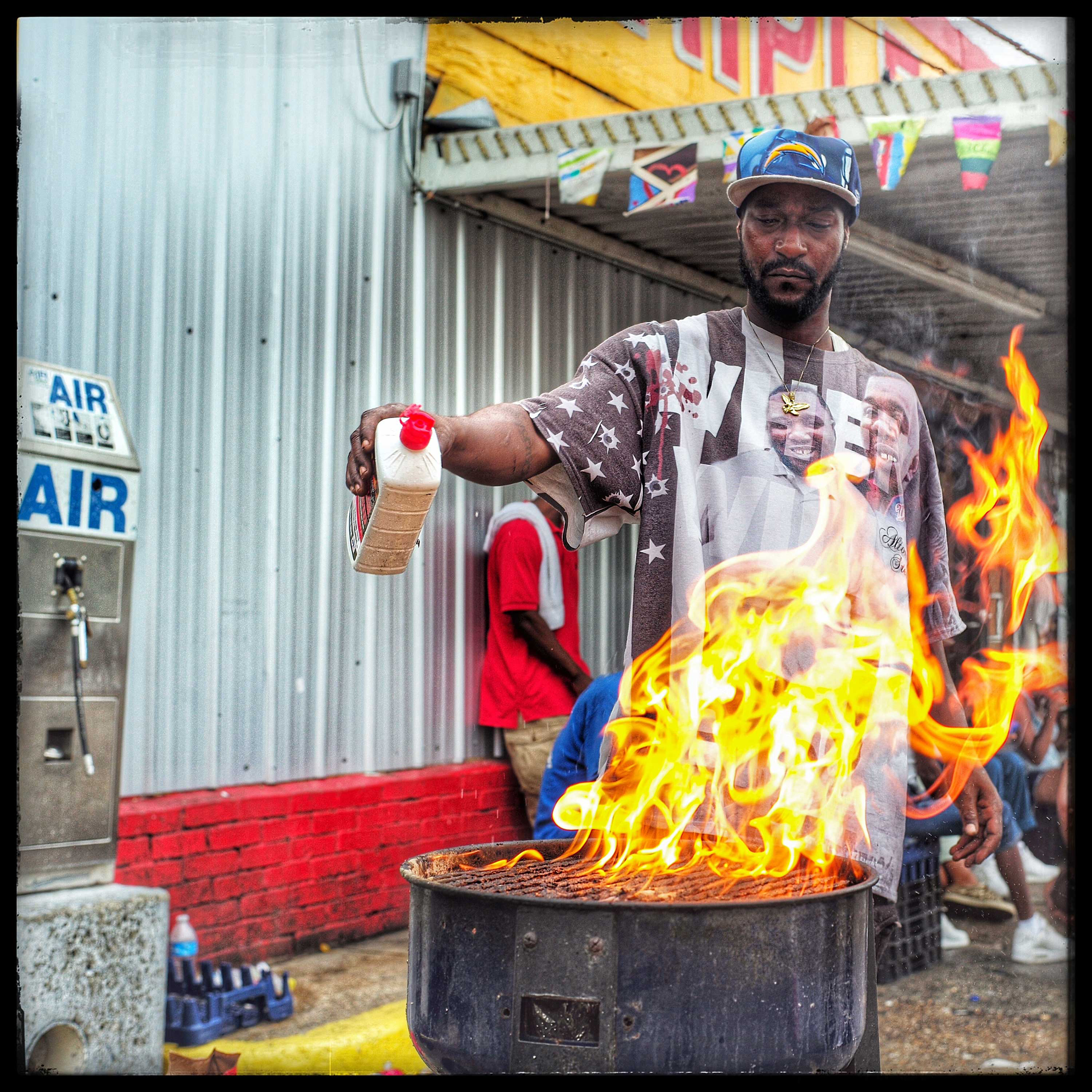 Baton Rouge, La:  Yes Sir, June like the month,  he said with a half smile. June has taken up the responsibility of helping to feed the small gathering that congregates in front of the Triple S Food Mart to pay their respects and grieve over the death of Alton Sterling.  I am here for everyone. Whoever comes here and need food I got them,  he said.