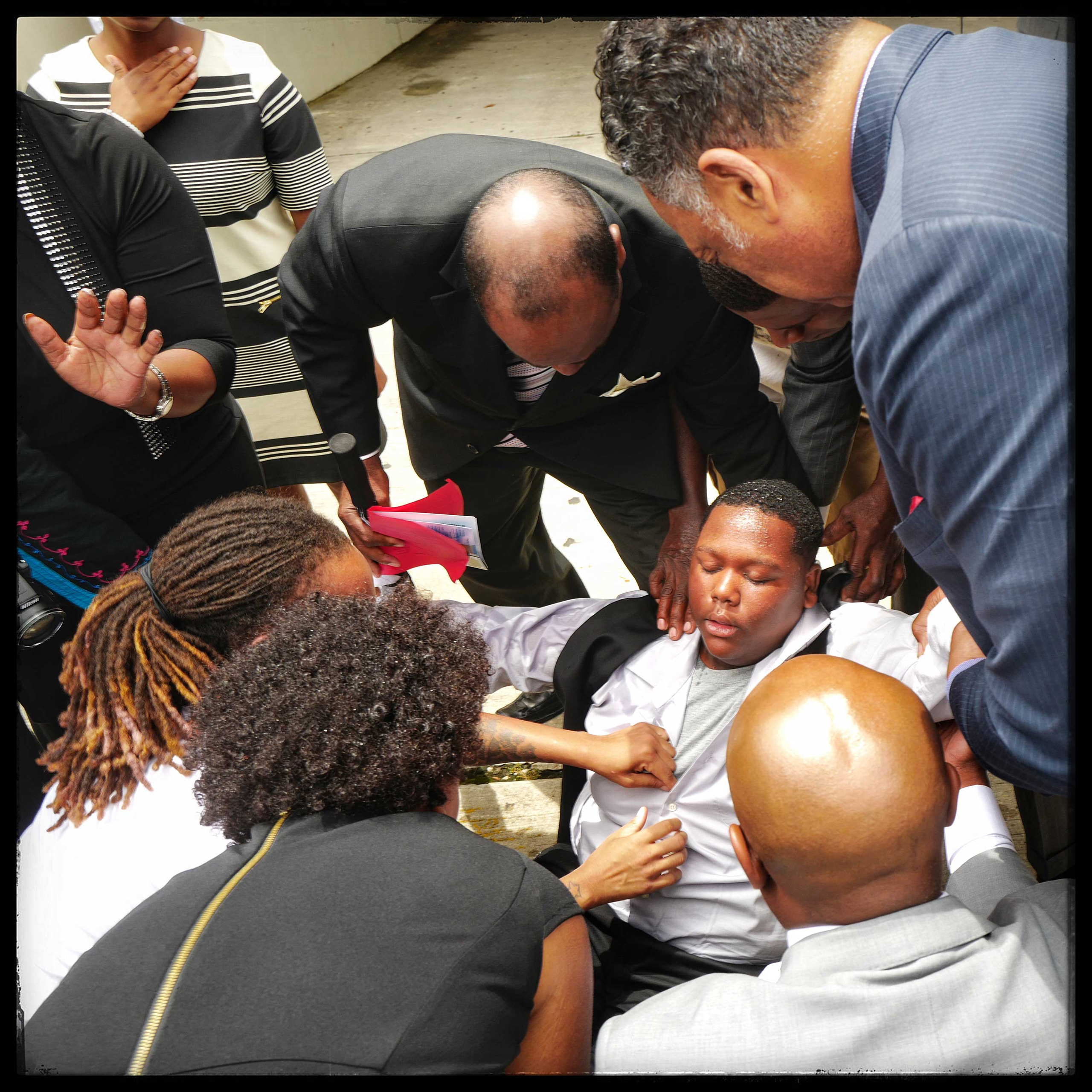 Baton Rouge, LA: Fifteen-year-old Cameron Sterling   collapses                               outside the church. He is led out of the funeral of his father, Alton                               Sterling, accompanied by the Rev. Jesse Jackson Sr. The funeral was held at                               the Southern University A&M College on July 15, 2016.