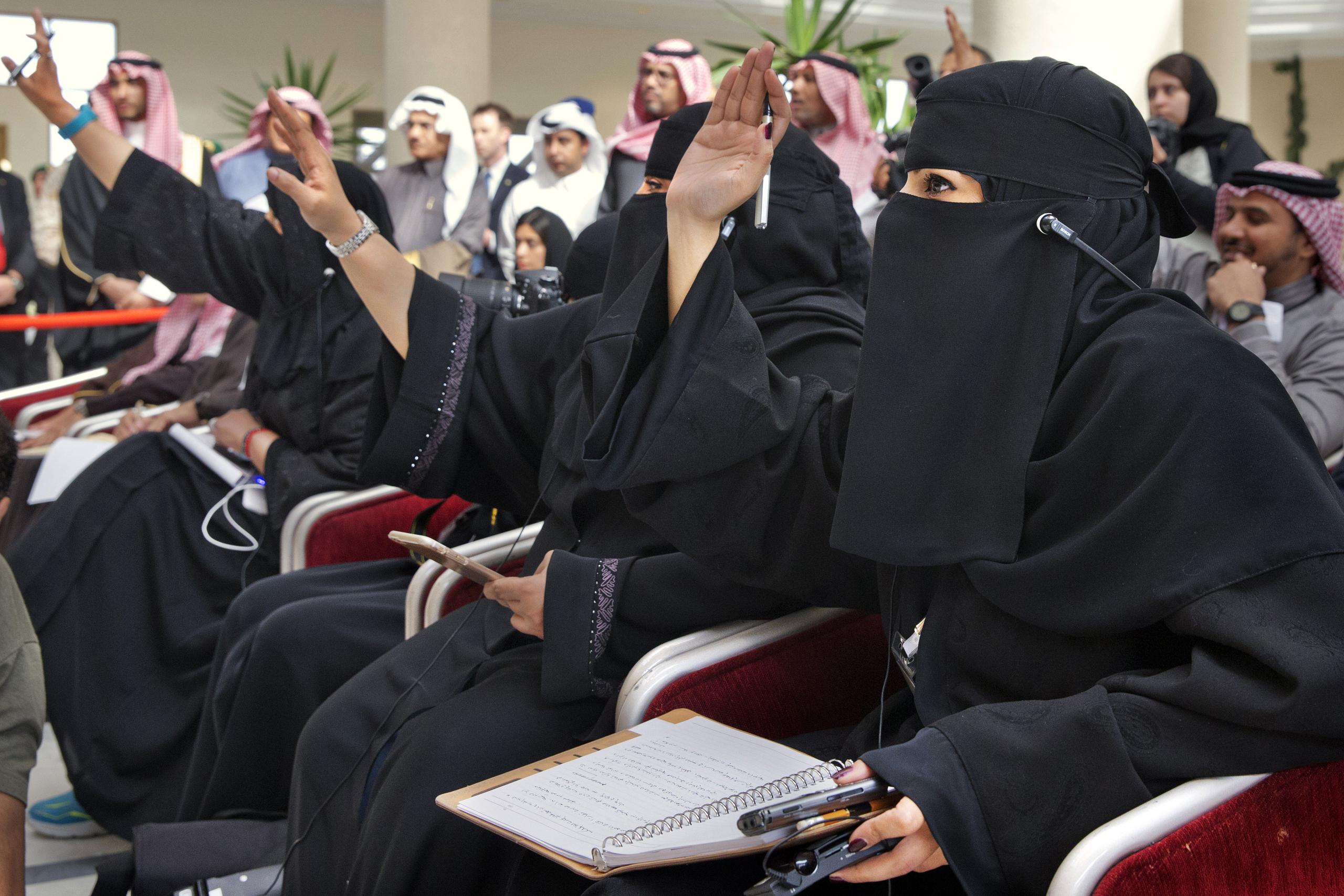 Saudi women journalists raise their hands to ask a question as U.S. Secretary of State John Kerry and Saudi Foreign Minister Adel al-Jubeir speak to members of the media at King Salman Regional Air Base in Riyadh, Saudi Arabia on Jan. 23, 2016.