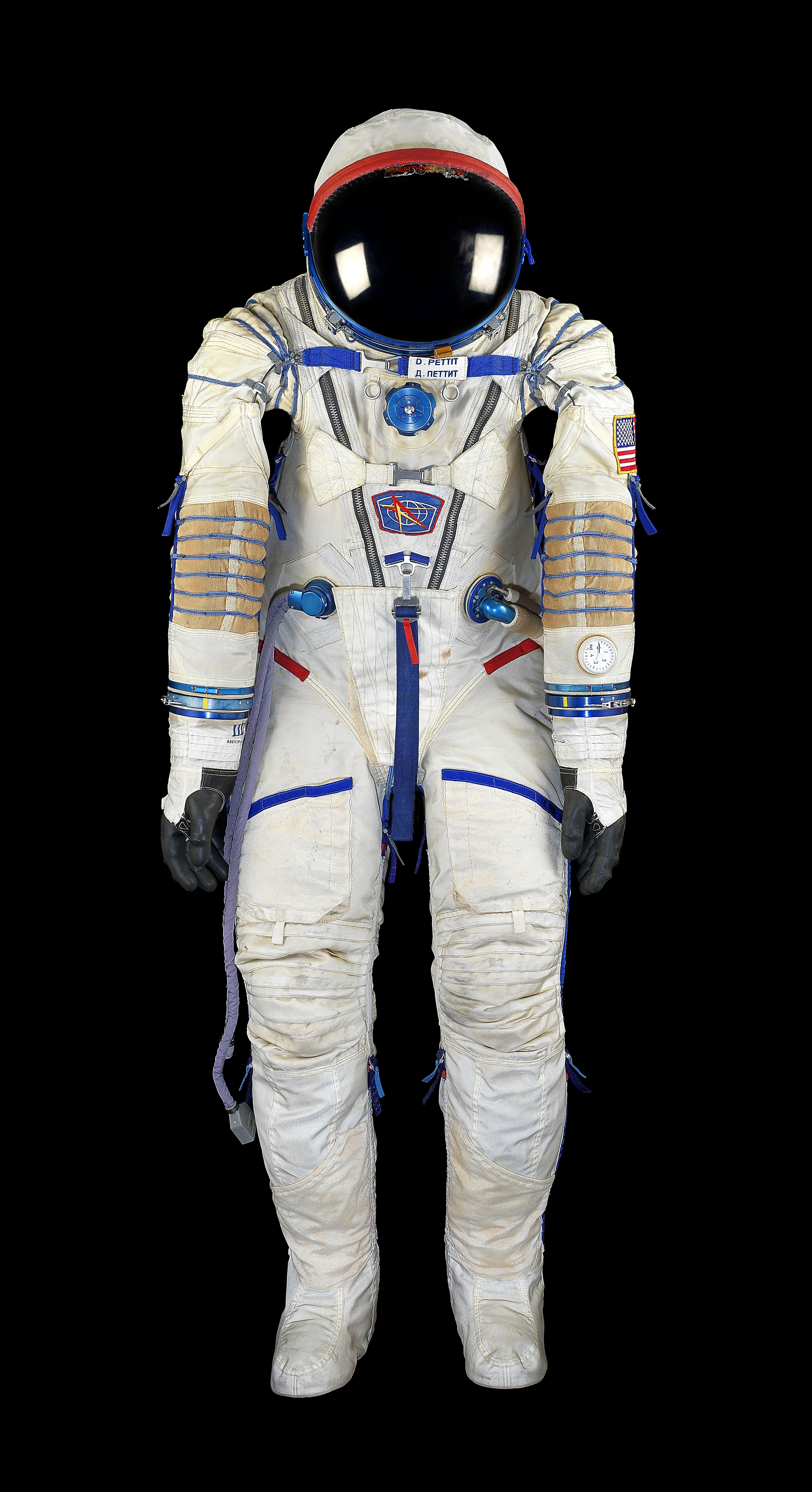 Space suit worn by flight engineer Don Petit on his dramatic return to Earth aboard the Soyuz TMA-1, following the Columbia disaster.